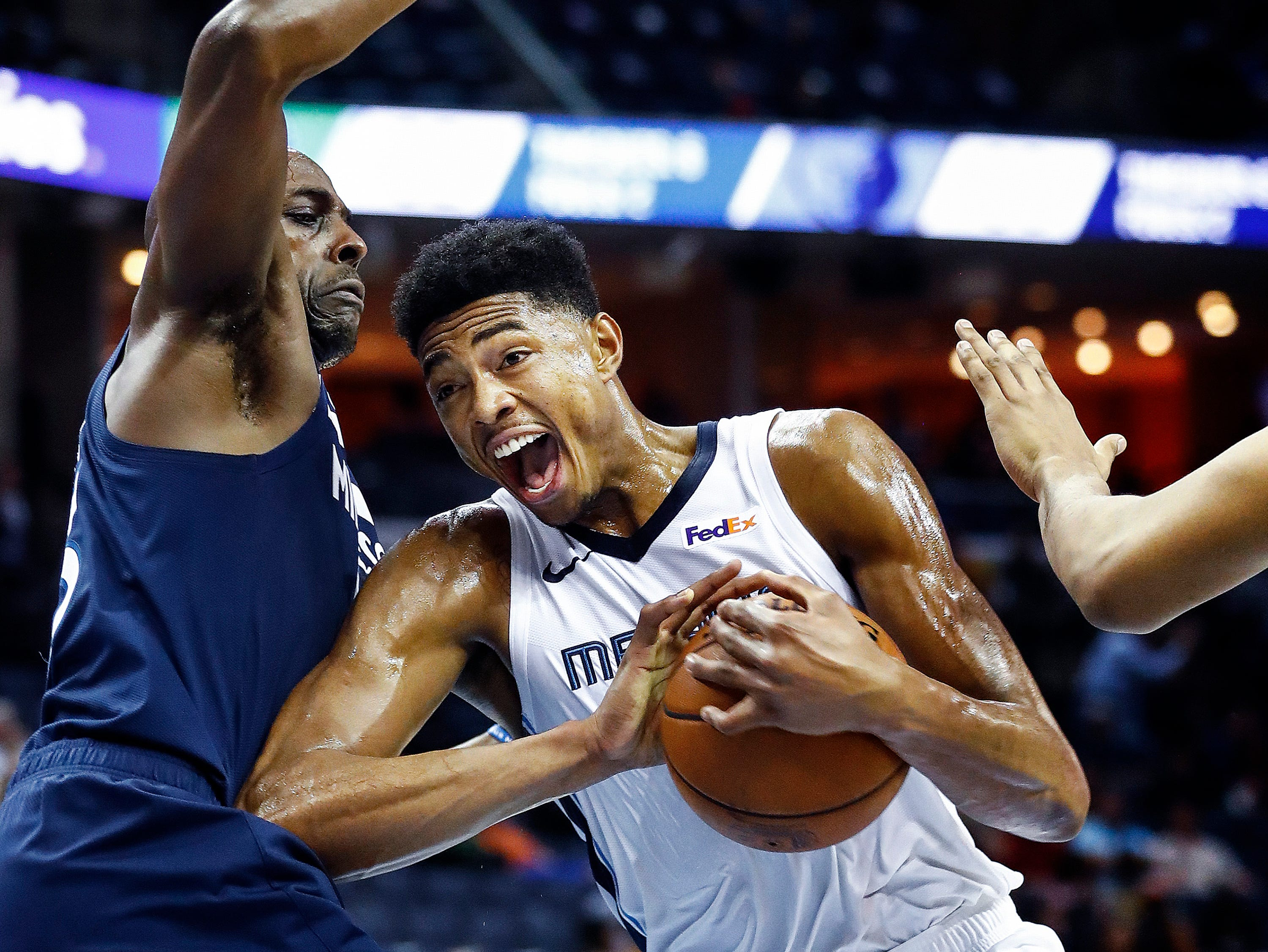 Memphis Grizzlies forward Bruno Caboclo (right) the lane against the Minnesota Timberwolves defense during first quarter action at the FedExForum in Memphis, Tenn., Tuesday, February 5, 2019.