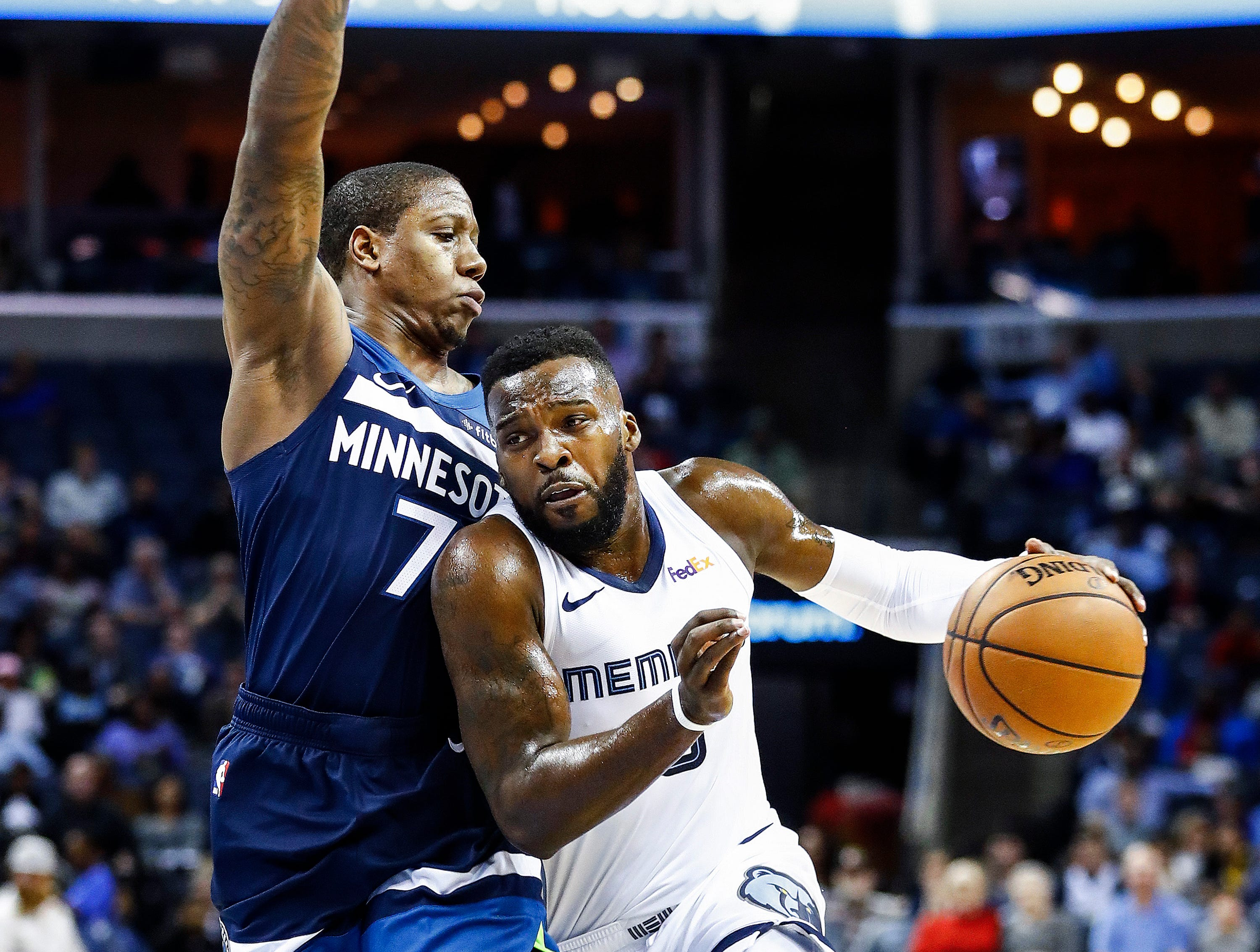 Memphis Grizzlies guard Shelvin Mack (right) drivers the lane against Minnesota Timberwolves defender Isaiah Canaan (left) during action at the FedExForum in Memphis, Tenn., Tuesday, February 5, 2019.