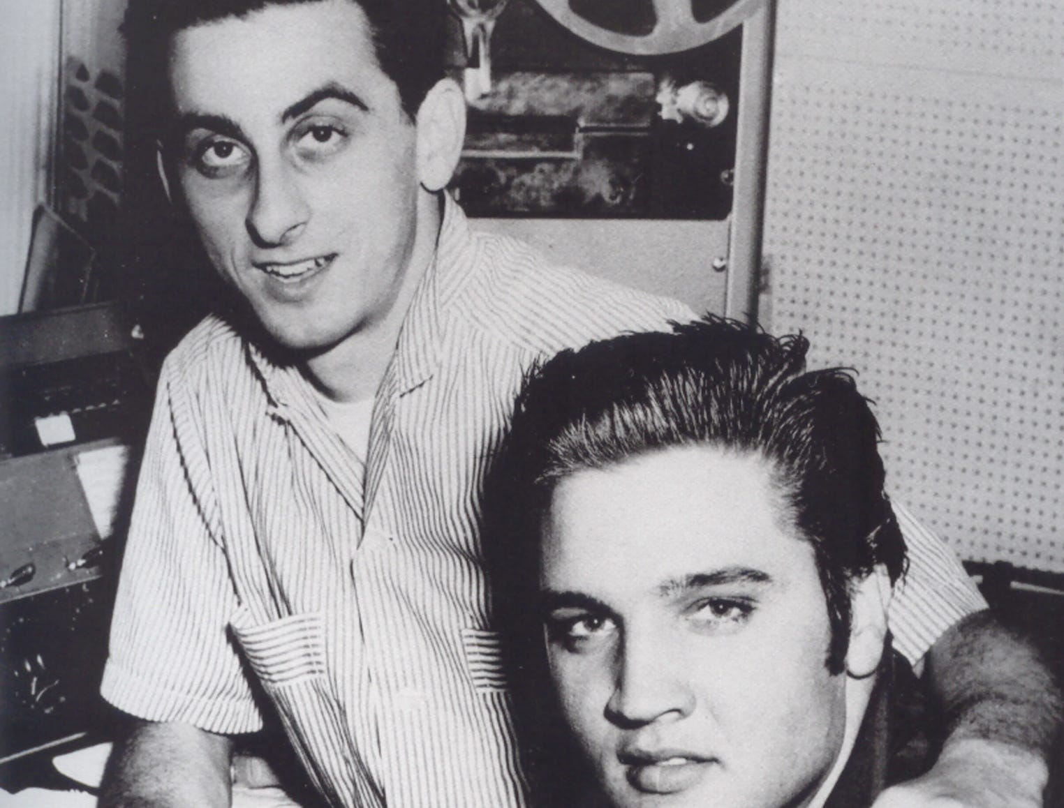Elvis Presley and George Klein are at WMC radio station in 1956.