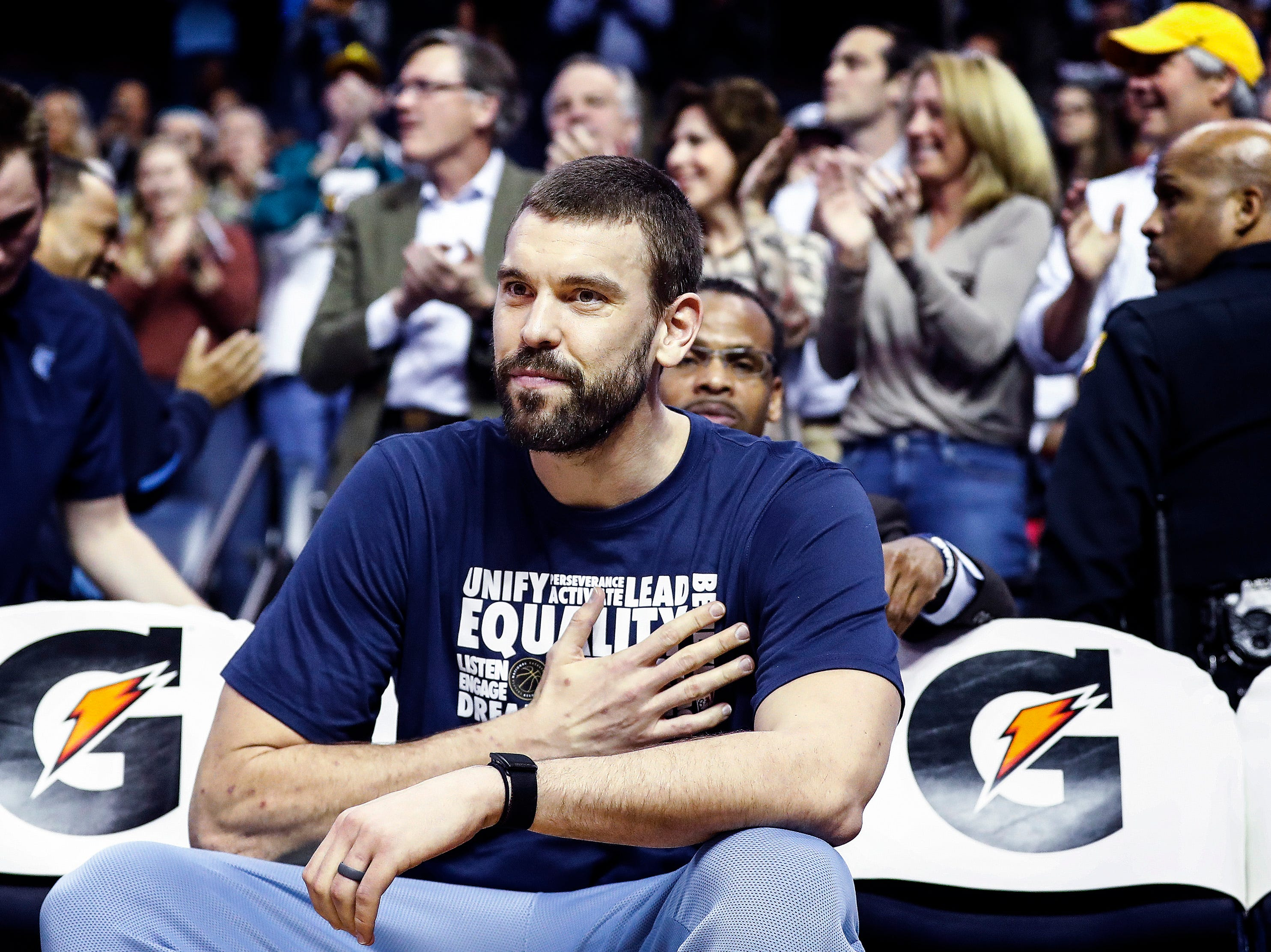 Memphis Grizzlies center Marc Gasol taps his chest over his heart as fans give him a standing ovation during acton against the Minnesota Timberwolves at the FedExForum in Memphis, Tenn., Tuesday, February 5, 2019. Gasol was sitting out the game, as trade rumors emerged that he would be heading to Hornets.