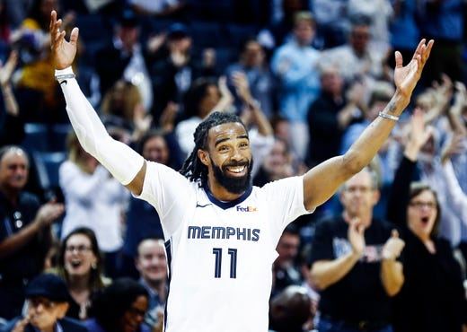Memphis Grizzlies guard Mike Conley celebrates at the half while taking on the Minnesota Timberwolves during action at the FedExForum in Memphis, Tenn., Tuesday, February 5, 2019.