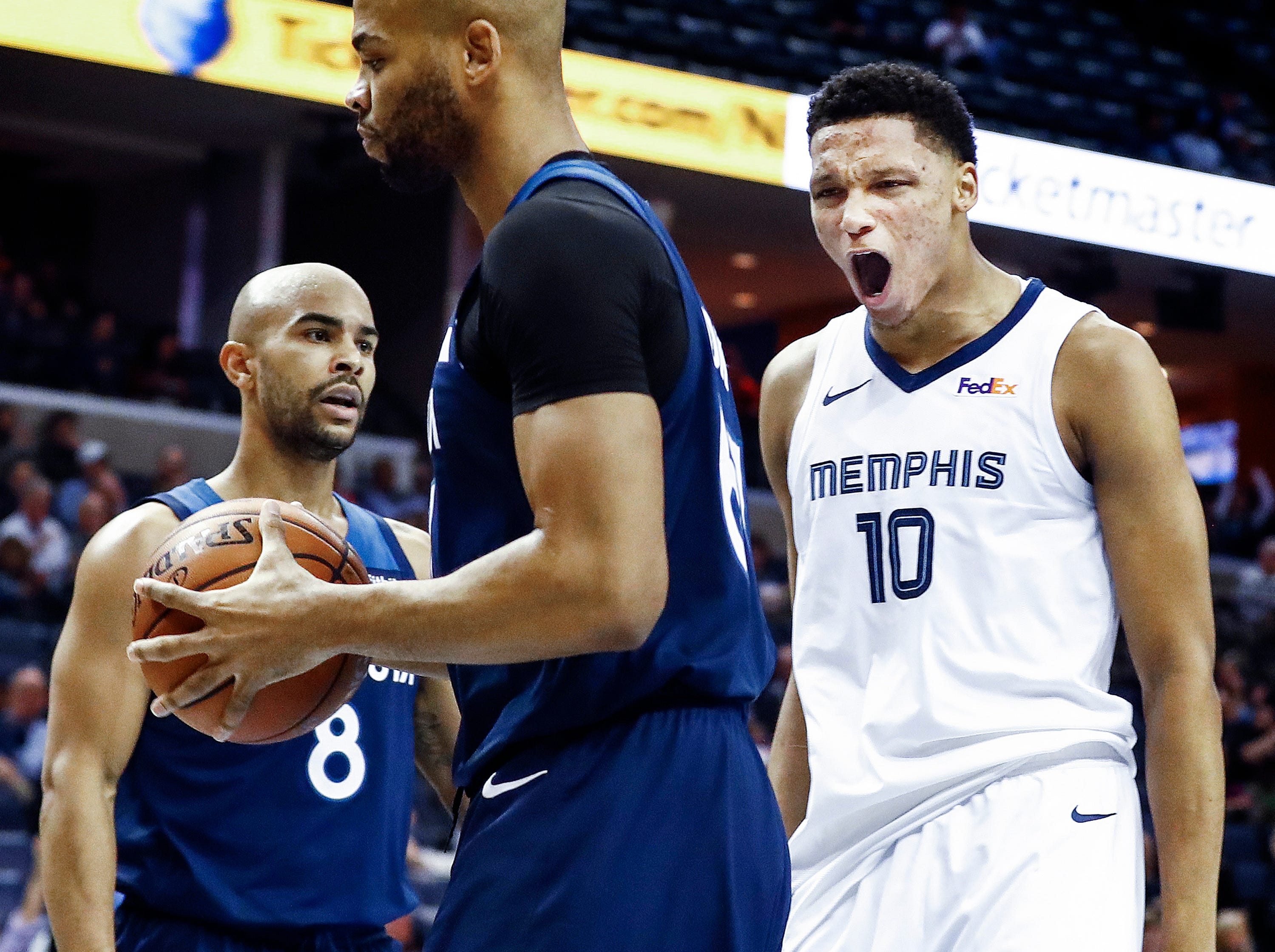 Memphis Grizzlies forward Ivan Rabb (right) celebrates in front of Minnesota Timberwolves teammates Taj Gibson (middle) and Isaiah Canaan (left) after a made basket during first quarter action at the FedExForum in Memphis, Tenn., Tuesday, February 5, 2019.