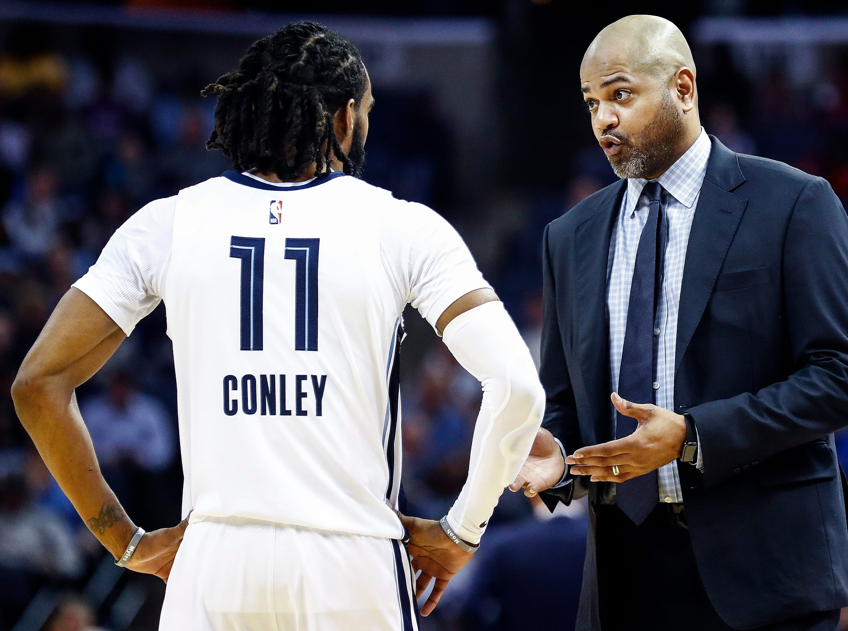 Memphis Grizzlies head coach J.B. Bickerstaff (right) talks to Mike Conley during action against the Minnesota Timberwolves at the FedExForum in Memphis, Tenn., Tuesday, February 5, 2019.