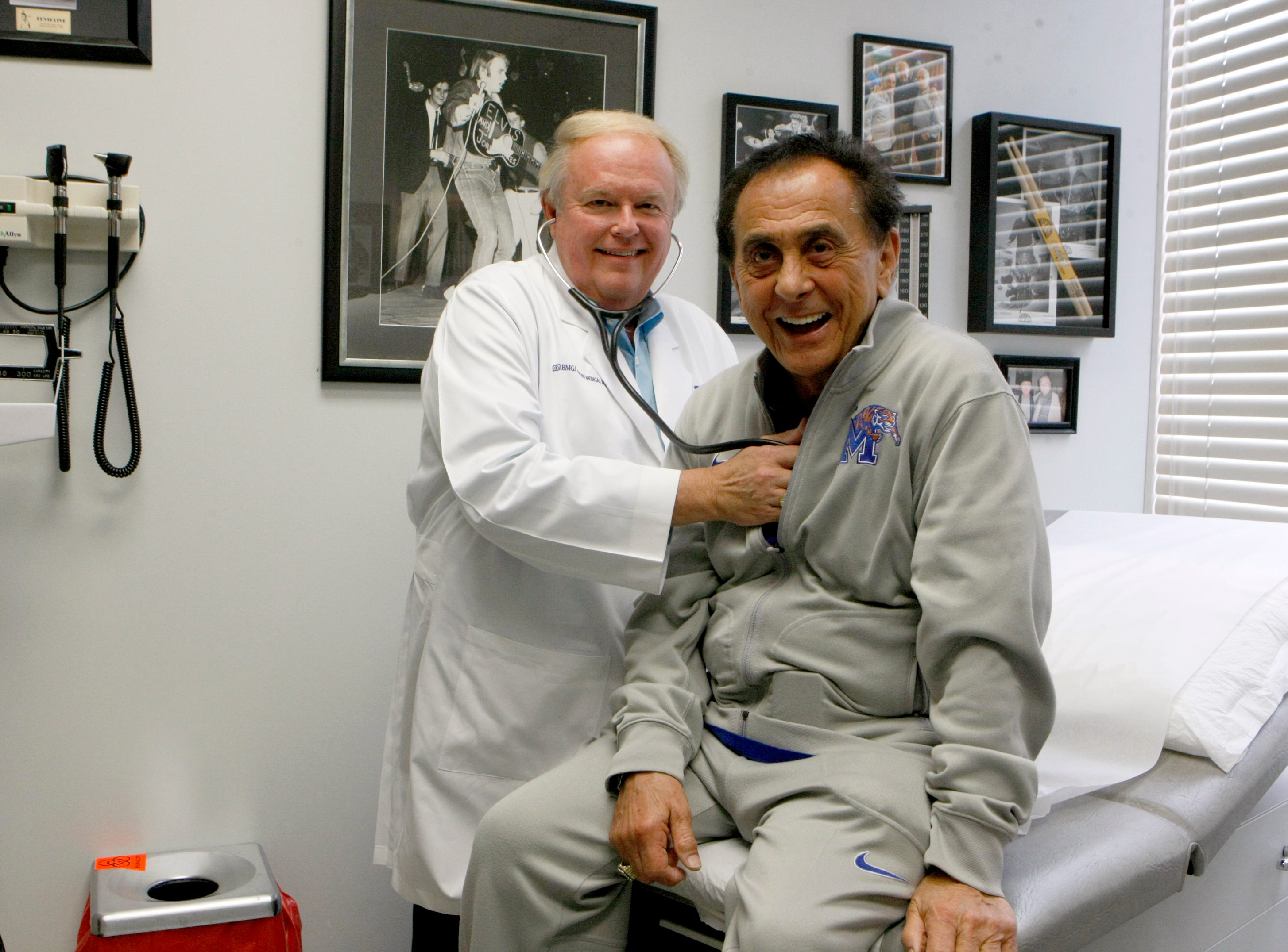 July 31, 2014 - Dr. Mark Castellaw is the doctor to many in the Presley inner circle, including longtime Elvis friend, George Klein. The doctor has an Elvis examination room, which holds much of the memorabilia  at the Baptist Medical Group office where he works. Castellaw was in practice with Dr. Nick, Elvis's doctor, for many years.