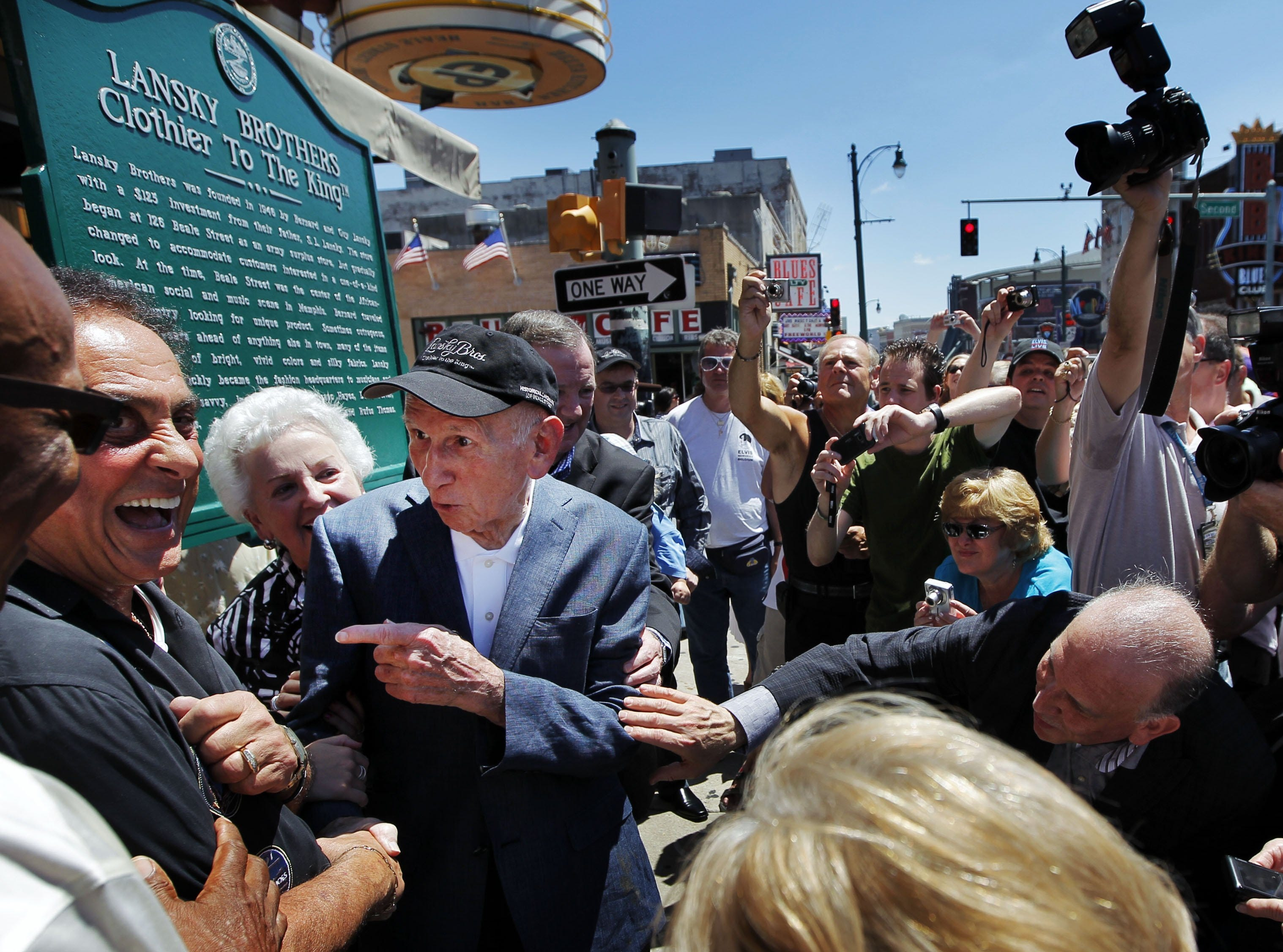 """August 14, 2011 - Memphis DJ George Klein (left) jokes with Lansky Brothers founder Bernard Lansky (second from left) """"Clothier to the King"""" during the unveiling of a new plaque to mark the original location of the historic clothing store on Beale St. Sunday afternoon."""