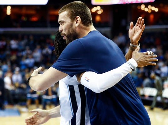 Memphis Grizzlies teammates Marc Gasol hugs Mike Conley at the half against Minnesota Timberwolves at the FedExForum in Memphis, Tenn., Tuesday, February 5, 2019.