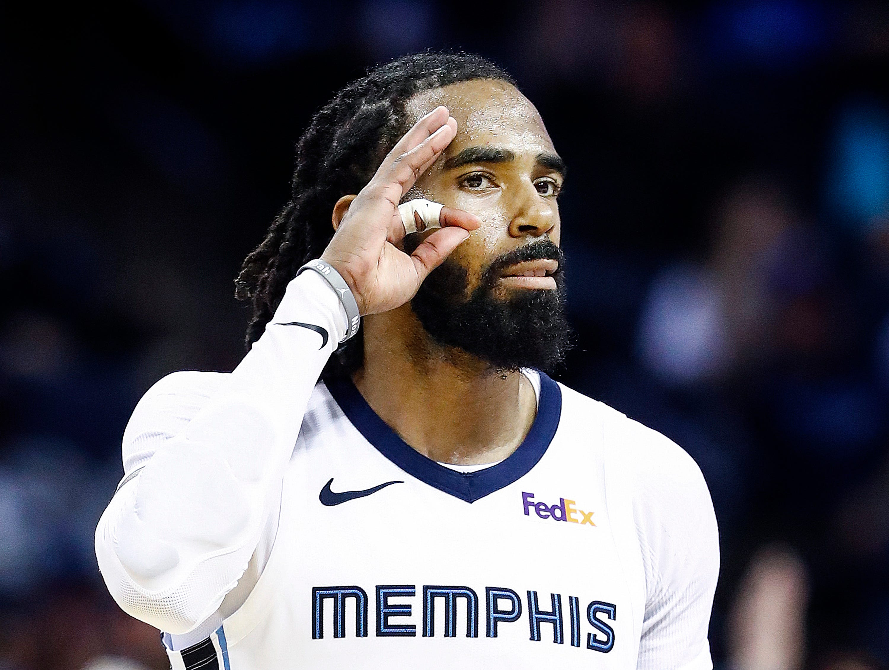 Memphis Grizzlies guard Mike Conley celebrates a made 3-pointer against the Minnesota Timberwolves defense during action at the FedExForum in Memphis, Tenn., Tuesday, February 5, 2019.