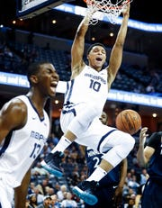 Memphis Grizzlies forward Ivan Rabb (top) celebrates a dunk with teammate Jaren Jackson Jr. (left) during action against the Minnesota Timberwolves at FedExForum on Feb. 5.