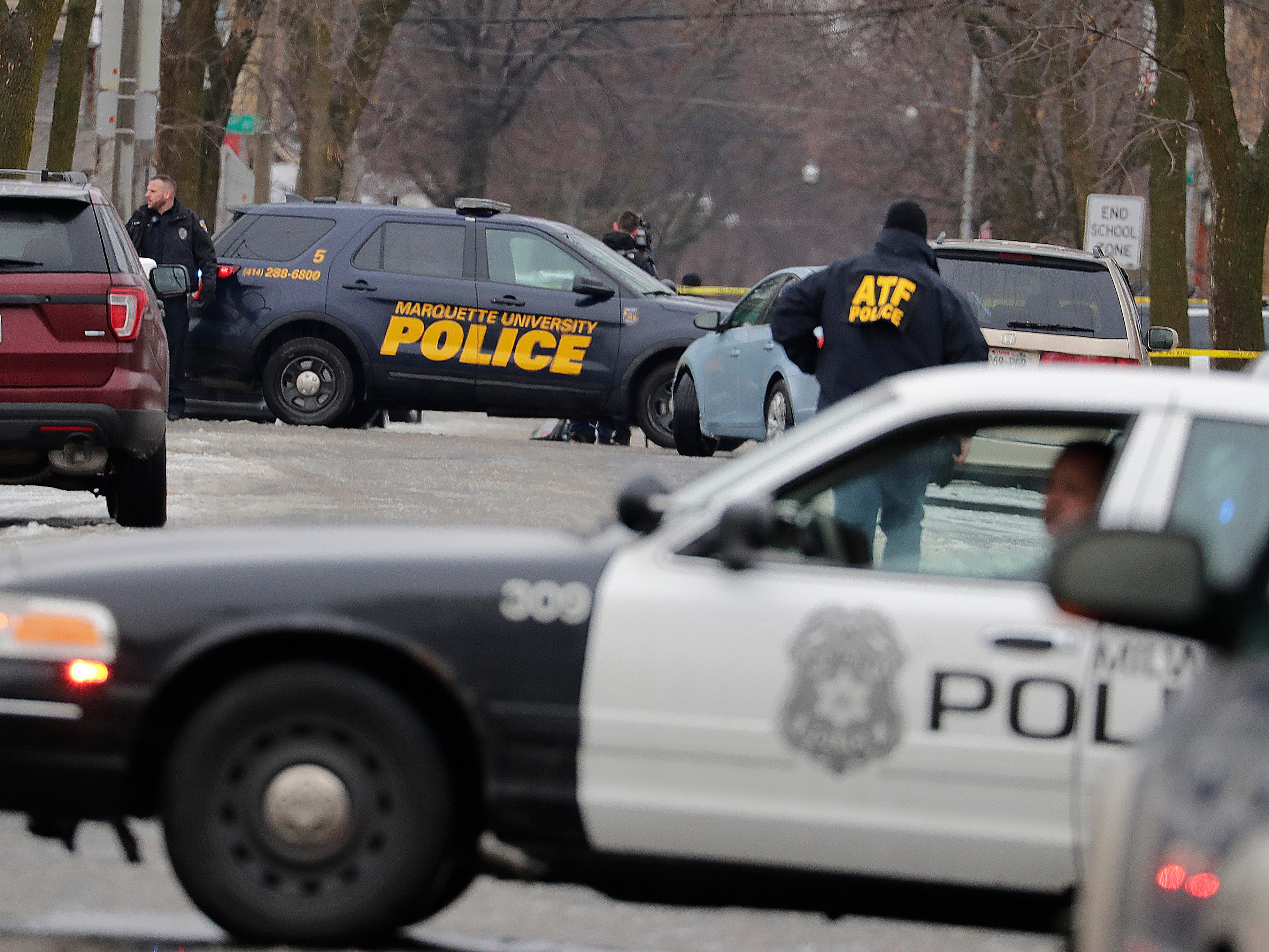 Officers block the intersection of South 12th and West Dakota streets near where a Milwaukee police officer was shot Wednesday morning on the city's south side. The shooting occurred during the execution of a search warrant at a residence. The officer, who was taken to Froedtert Hospital for treatment, died.