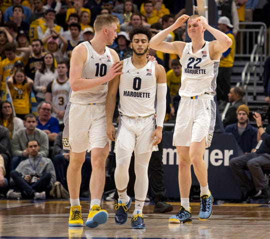 Marquette forward Sam Hauser (left) consoles both Markus Howard and brother Joey Hauser after Howard missed the potential winning shot in the waning seconds of the game against St. John's and Joey let the potential rebound slip through his hands.