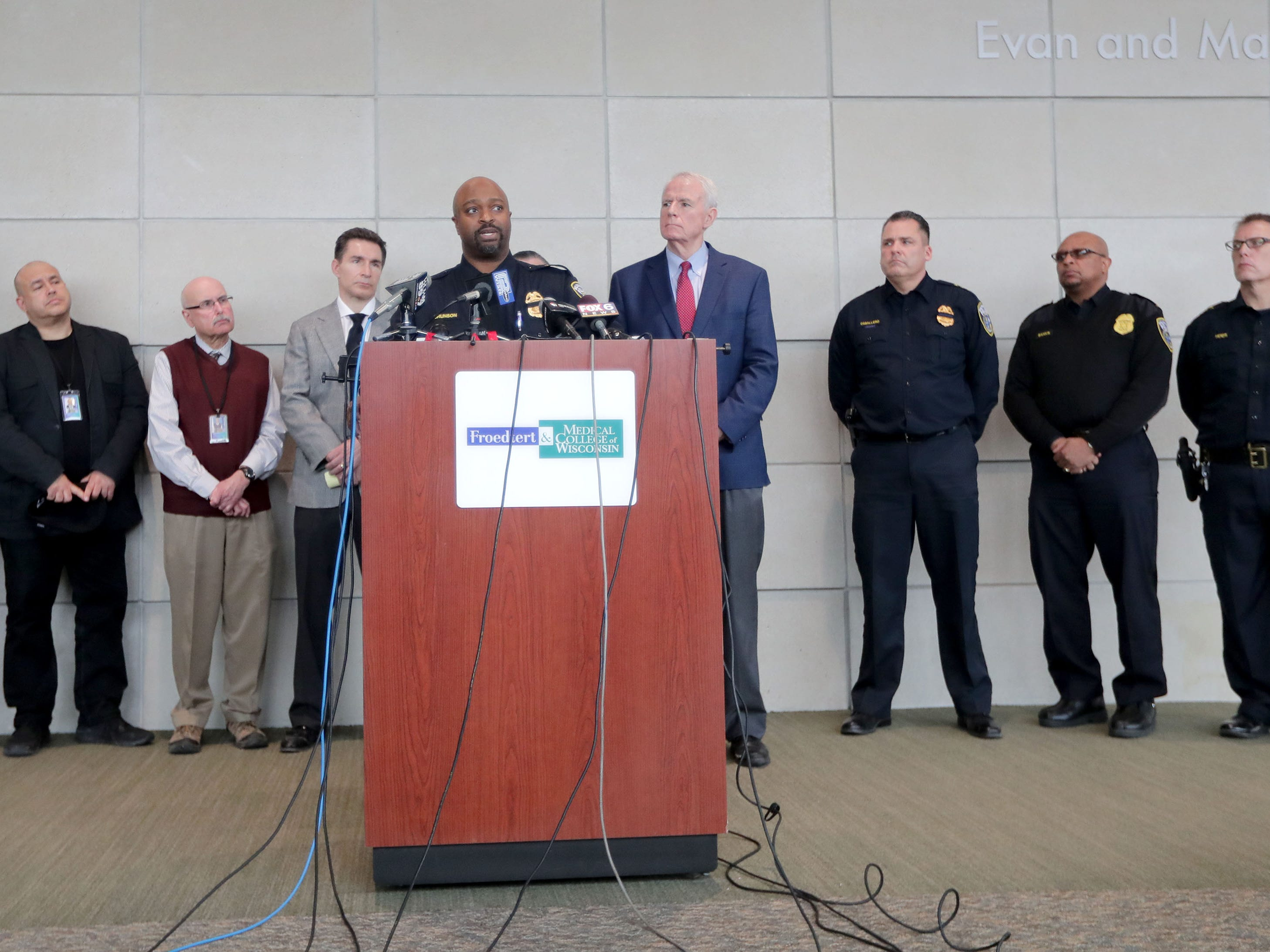 Assistant Milwaukee Police Chief Michael Brunson Sr. speaks surrounded by law enforcement officials during a news conference at Froedtert Hospital in Milwaukee on Wednesday about a Milwaukee police officer who was shot and killed in the line of duty Wednesday morning on Milwaukee's south side.