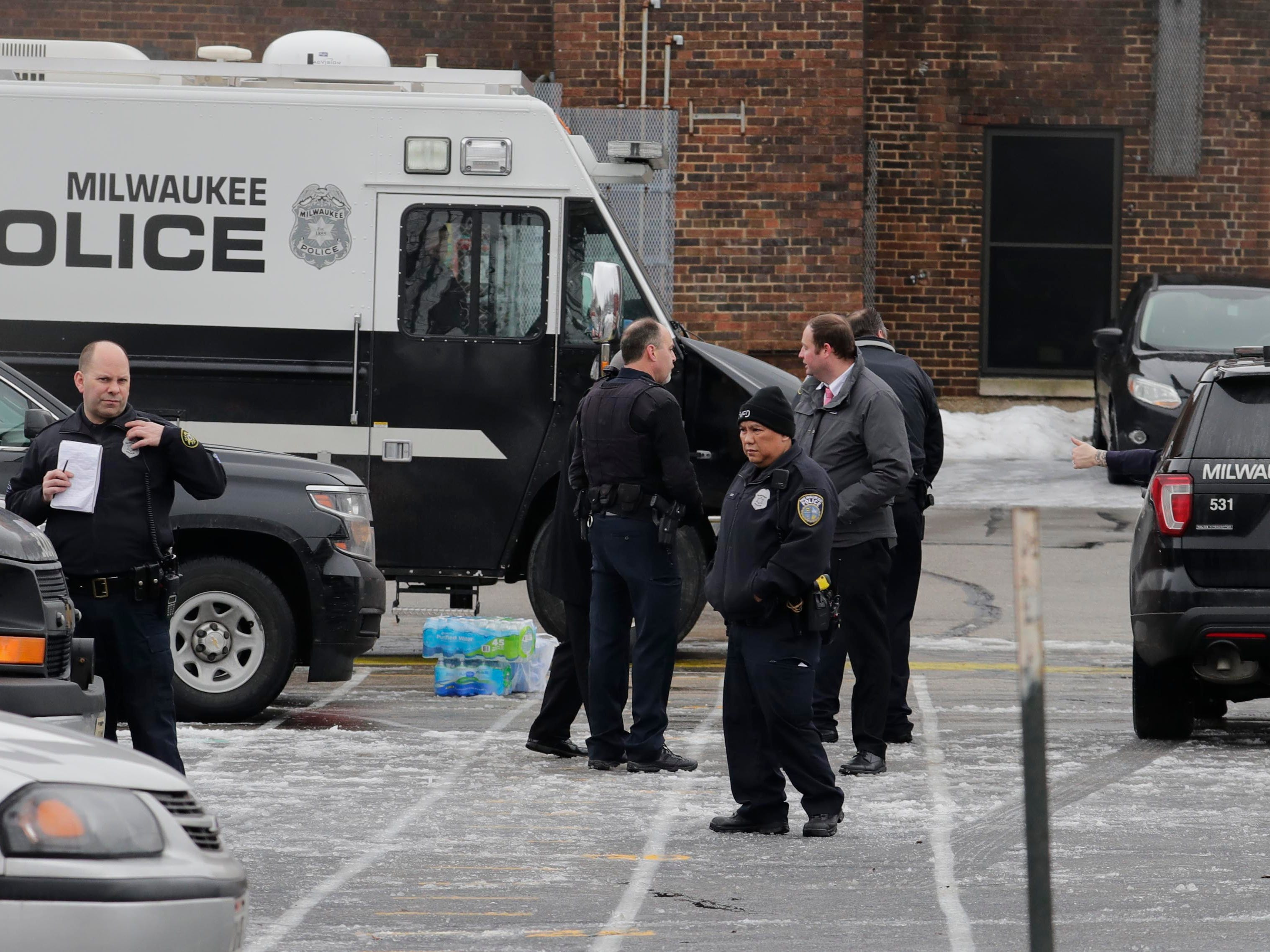 Police established a command center on  the playground of Clement Zablocki Elementary School.