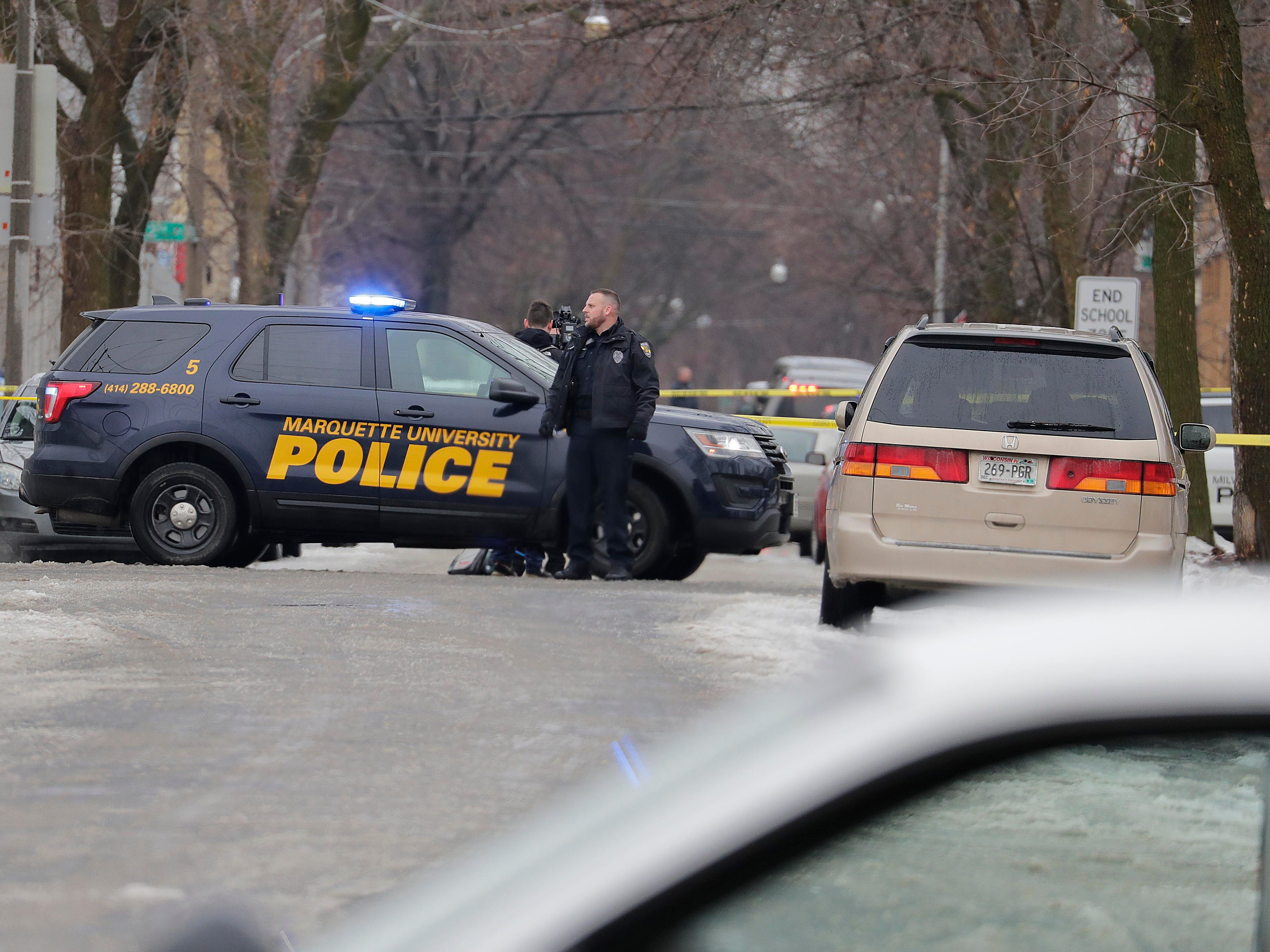 Milwaukee police block the intersection of South 12th and West Dakota streets near where an officer was shot. The officer died Wednesday morning and a suspect is in custody.