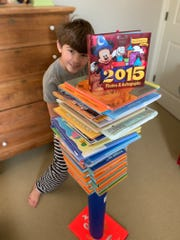 University School of Milwaukee third-grader George Endres participates in a challenge to build a column out of paper and stack as many books on top of it as possible. It was one of many assignments USM teachers gave as part of an online learning day Jan. 31, when the school was closed by inclement weather.