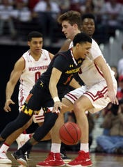 Wisconsin forward Nate Reuvers (right) has battled foul trouble in each of the Badgers' last three games.