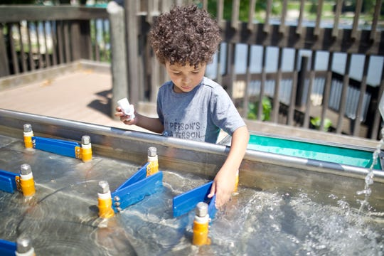 Discovery Park, the outdoor area at the Discovery Center Museum in Rockford, includes a water table for kids to play at.