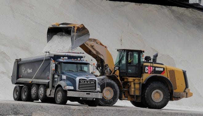 Front end loaders fill trucks with salt to spread on roads ahead of a wintry mix of sleet, freezing rain and possibly snow moving in to southern Wisconsin. They were loading the salt at Jones Island, Tuesday, February 5, 2019.