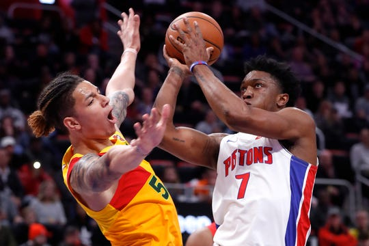 Milwaukee Bucks forward D.J. Wilson (5) fouls Detroit Pistons forward Stanley Johnson (7) in the second half of an NBA basketball game in Detroit, Monday, Dec. 17, 2018. (AP Photo/Paul Sancya) ORG XMIT: MIPS110