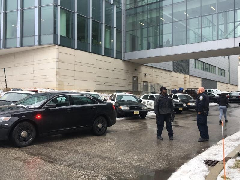 Law enforcement officers gather at Froedtert Hospital where a Milwaukee police officer who was shot Wednesday morning was taken. The officer died and a suspect is in custody.