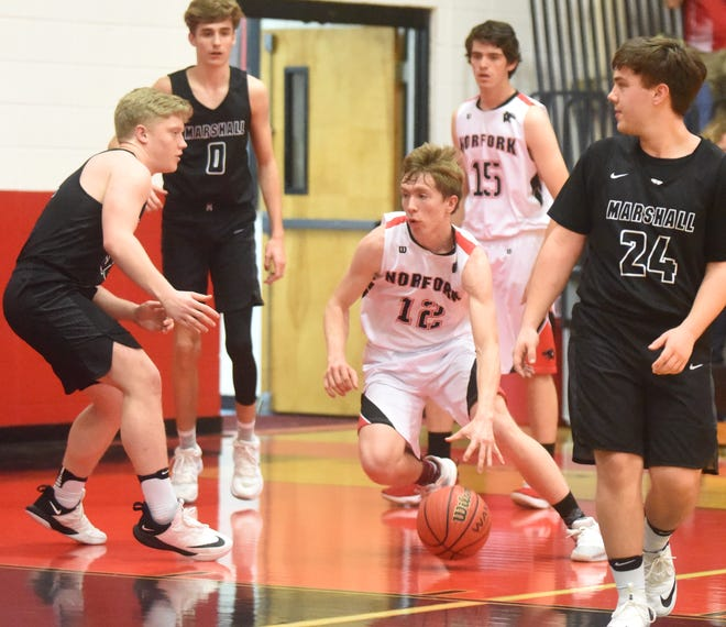 Norfork's Jaden McFall dribbles to the basket against Marshall on Tuesday night.