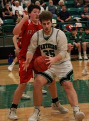 Yellville-Summit's J.T. Frazier is guarded by Flippin's Dale Smyser on Tuesday night.