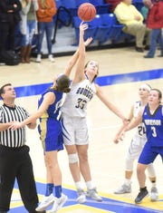 Mountain Home's Anna Grace Foreman wins a jump ball during a game earlier this season.
