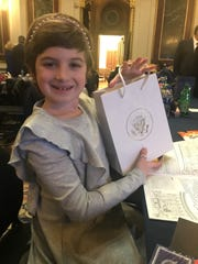 Grace Eline, a 10-year-old cancer survivor from Long Hill, shows off the gift bag she received prior to Tuesday night's State of the Union address.