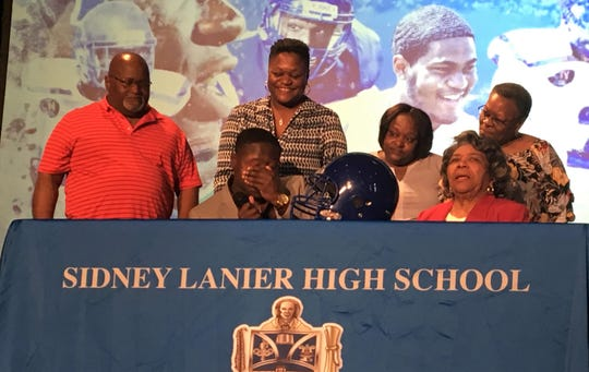 Lanier Senior Noah Hart announces his decision to sign with Division II Tuskegee University on Tuesday, Feb. 6.