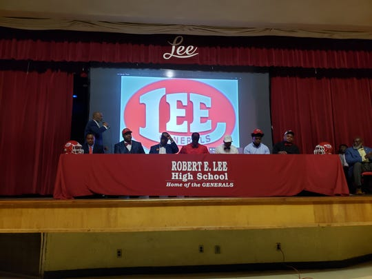 Lee High School football players chose their colleges in front of classmates on National Signing Day
