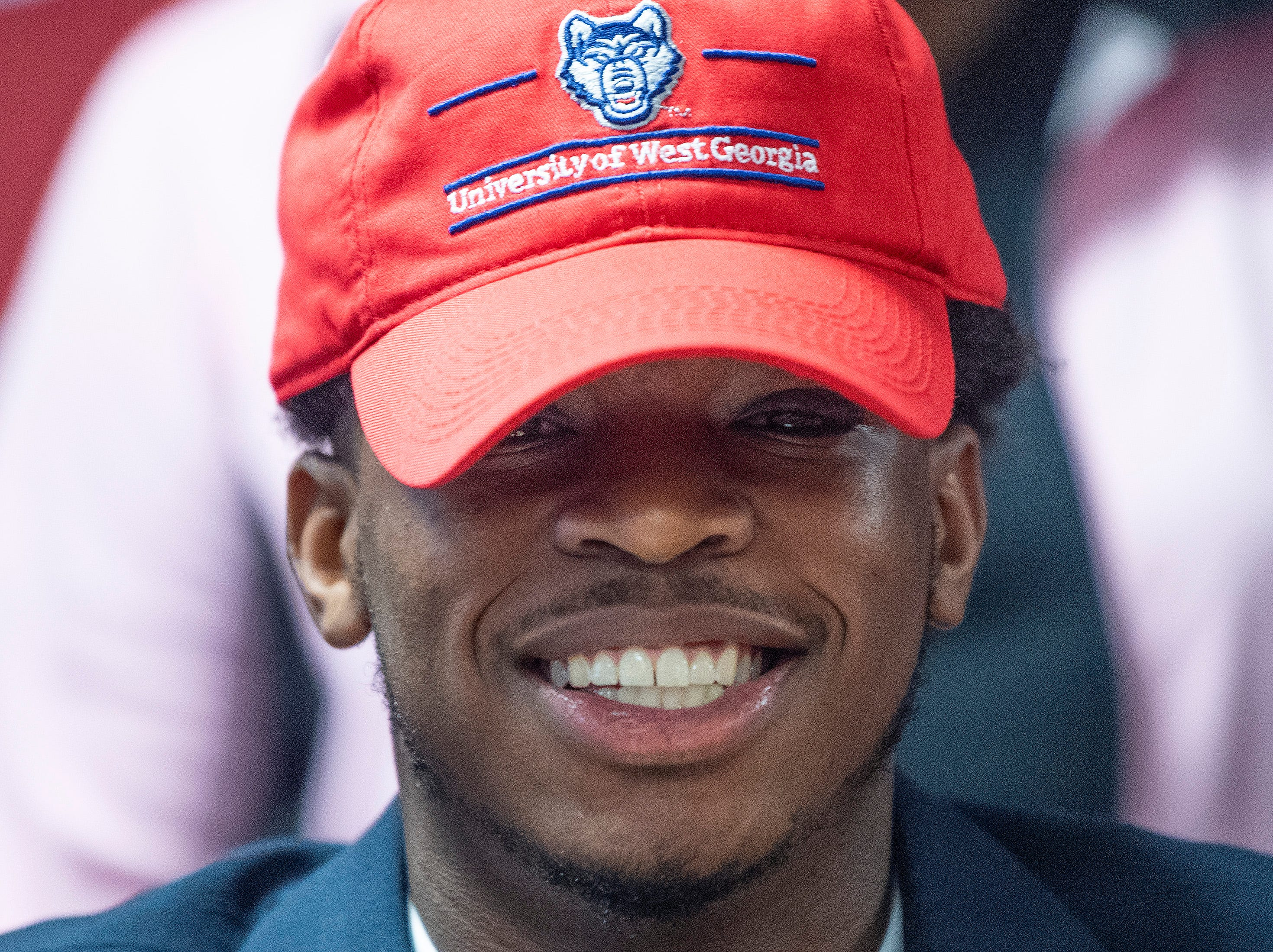 Prattville's Malik Smith signs to play at West Georgia during college football signing day at the school's campus in Pratttville, Ala., on Wednesday February 6, 2019.
