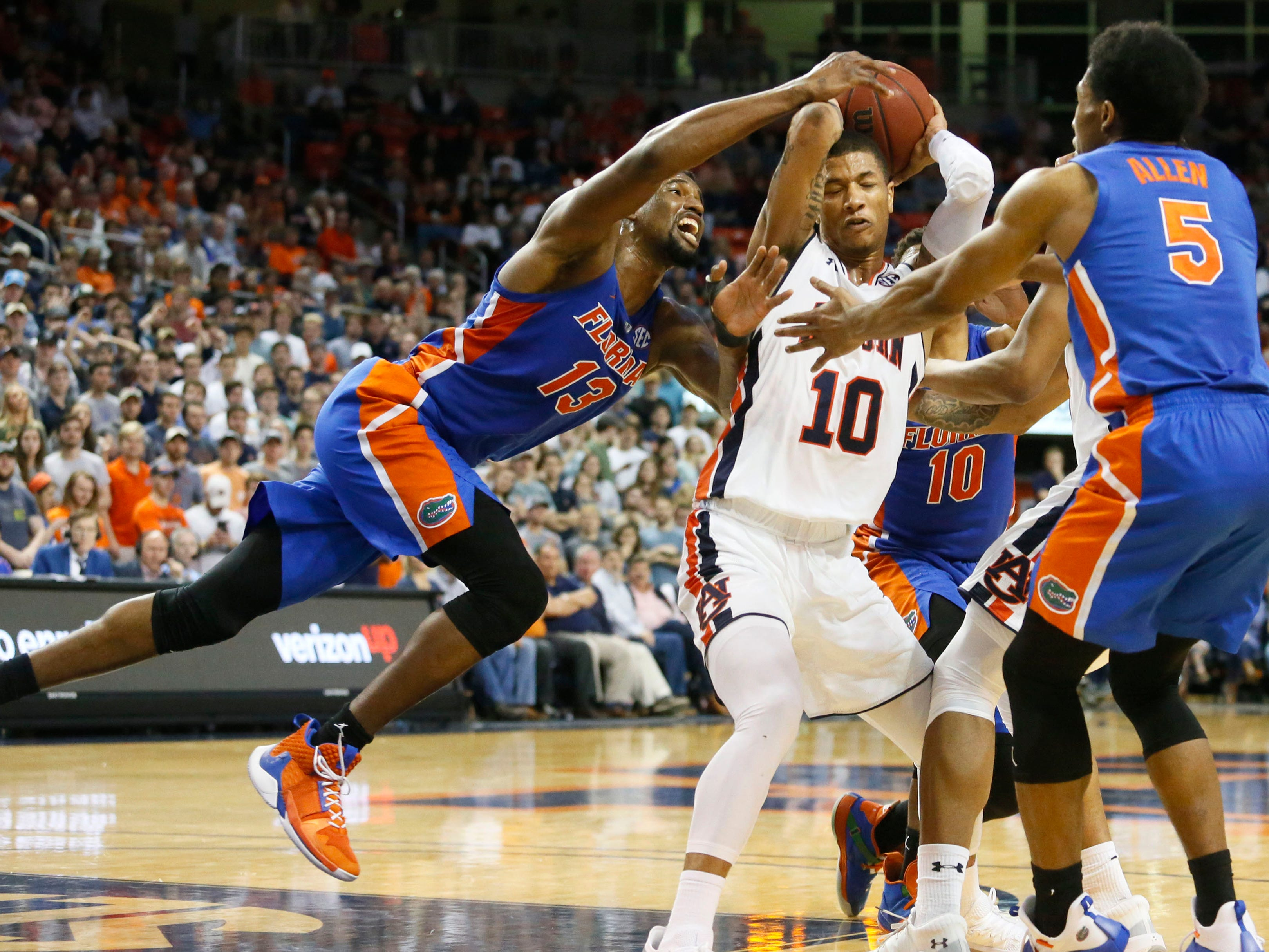 Feb 5, 2019; Auburn, AL, USA; Auburn Tigers guard Samir Doughty (10) is pressured by Florida Gators guard Kevaughn Allen (5) and center Kevarrius Hayes (13) during the second half at Auburn Arena. Mandatory Credit: John Reed-USA TODAY Sports