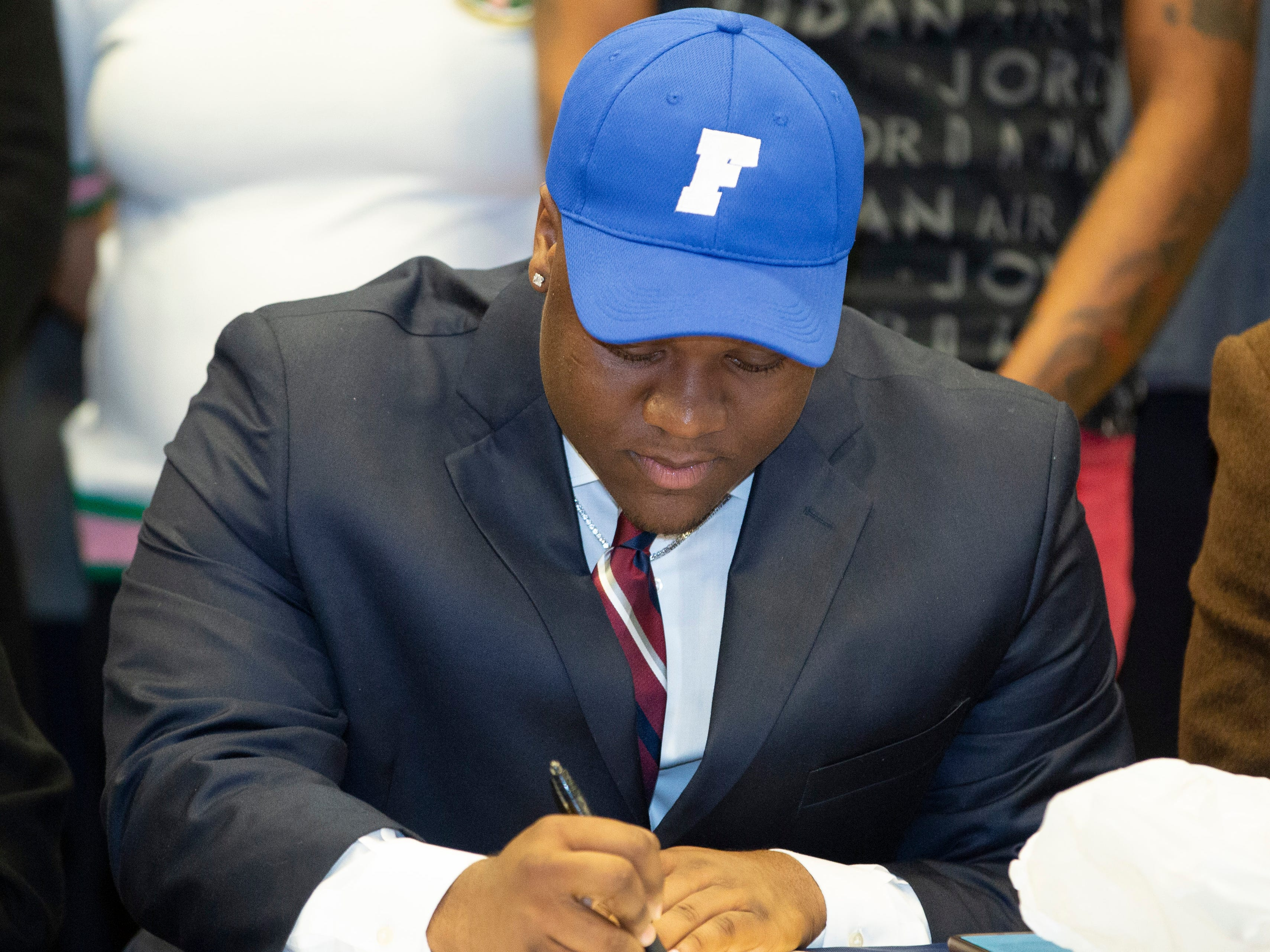 Evan Batin, a football player at Park Crossing, signed with Faulkner.