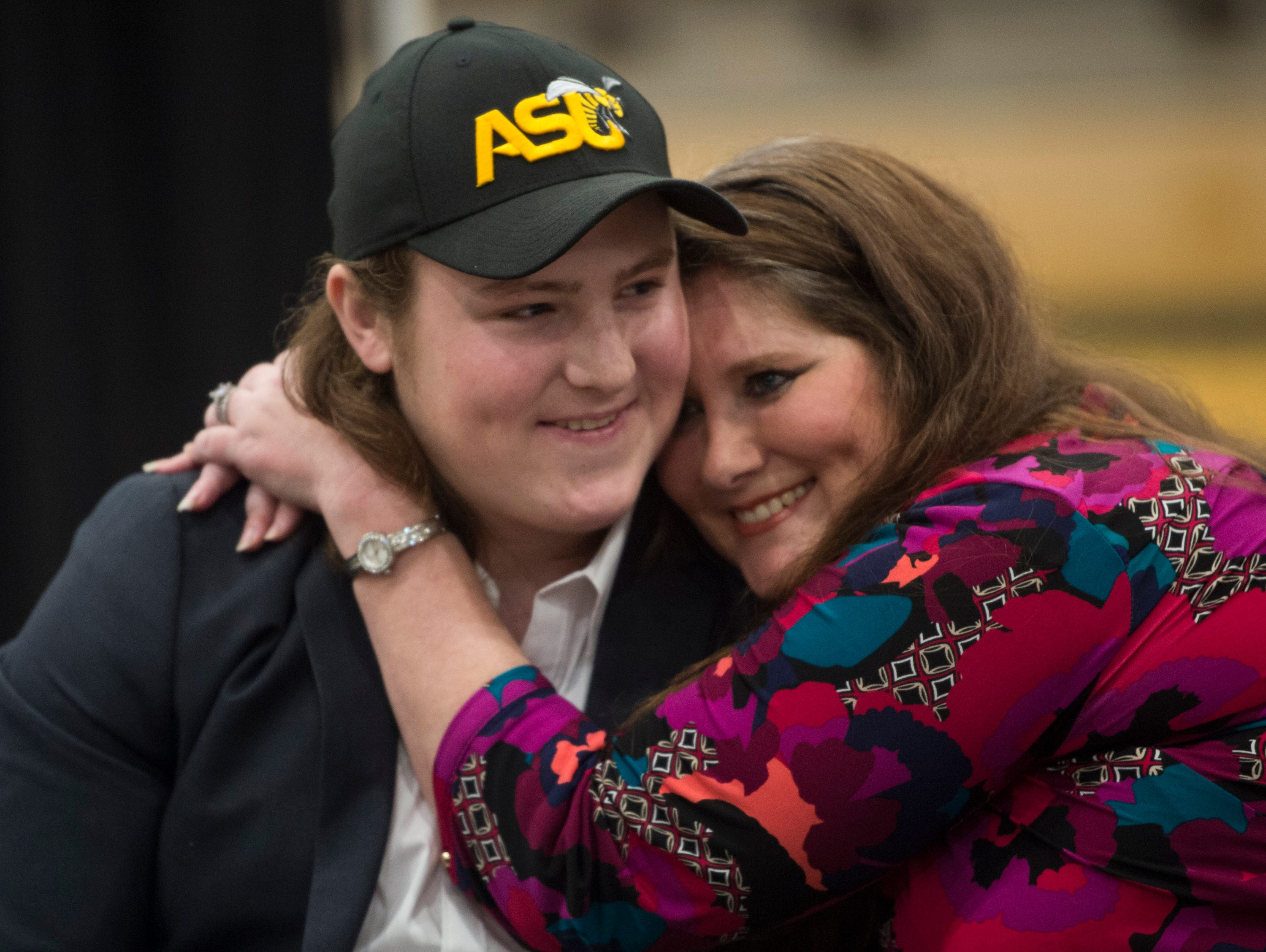 Colton Adams gets a hug from his mom after announcing his signing with Alabama State during signing day at Wetumpka High School in Wetumpka, Ala., on Wednesday, Feb. 6, 2019.