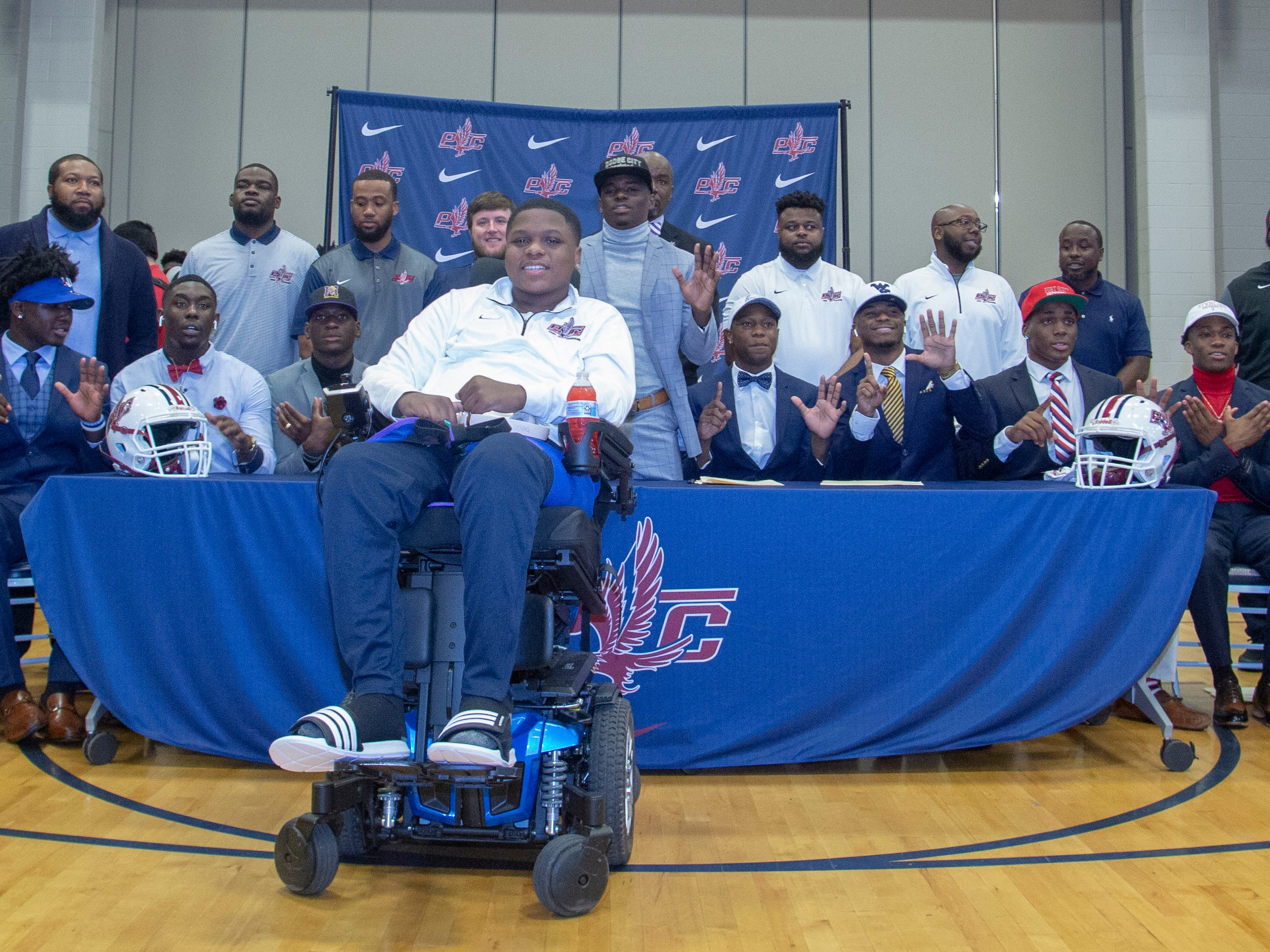 The largest signing class for football at Park Crossing gathers for a photo together.
