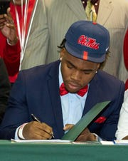 Brandon Mack, a defensive end at Jeff Davis High School, signed with Ole Miss to play football.