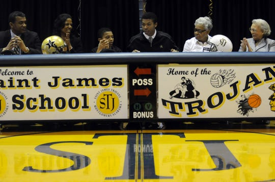 Saint James' CJ Duncan signs a letter of intent to play football for Vanderbilt University on Wednesday, Feb. 6, 2013.