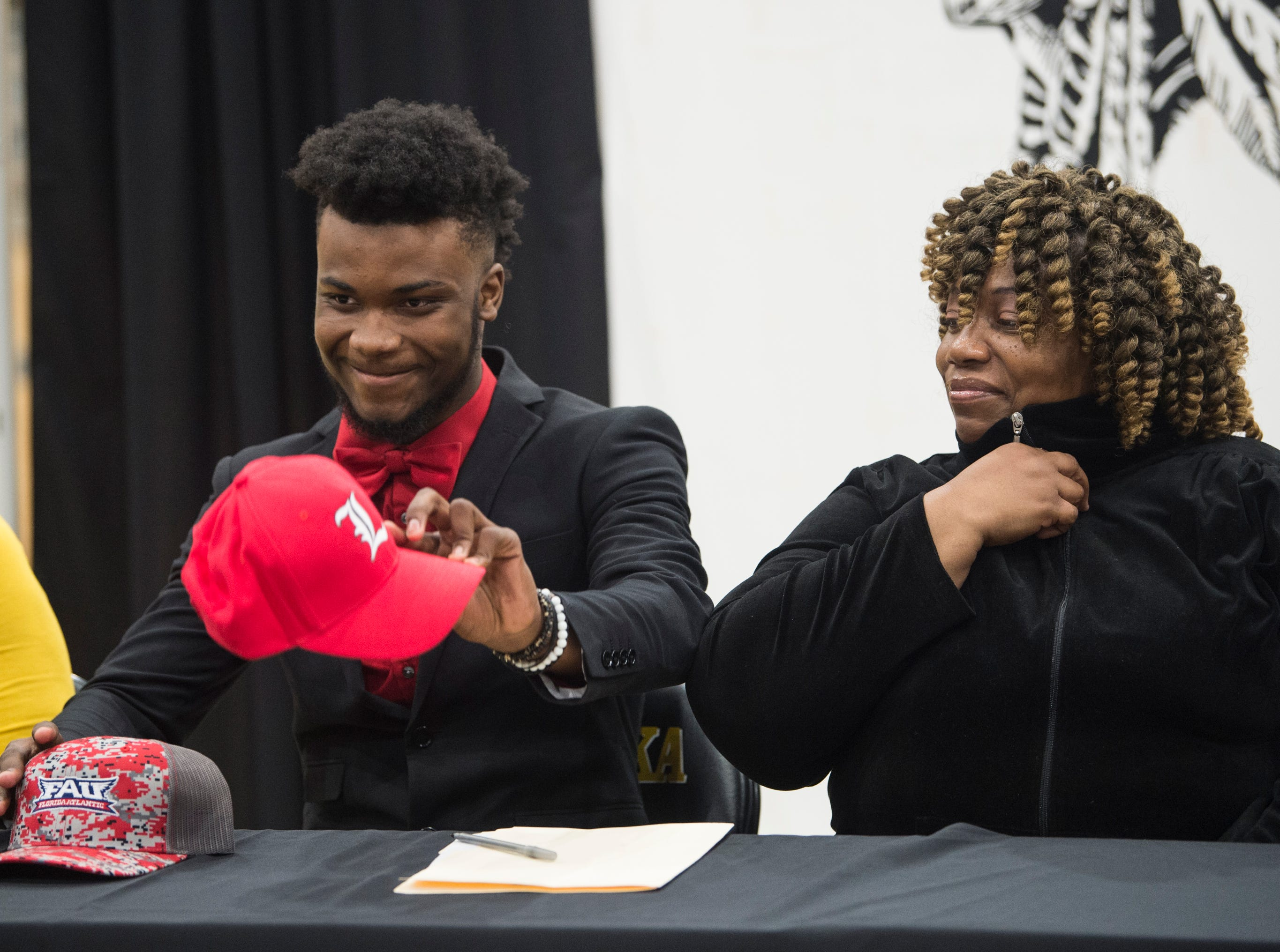 JD Martin fakes out the crowd with the Louisville hat before announcing his signing with Florida Atlantic during signing day at Wetumpka High School in Wetumpka, Ala., on Wednesday, Feb. 6, 2019.