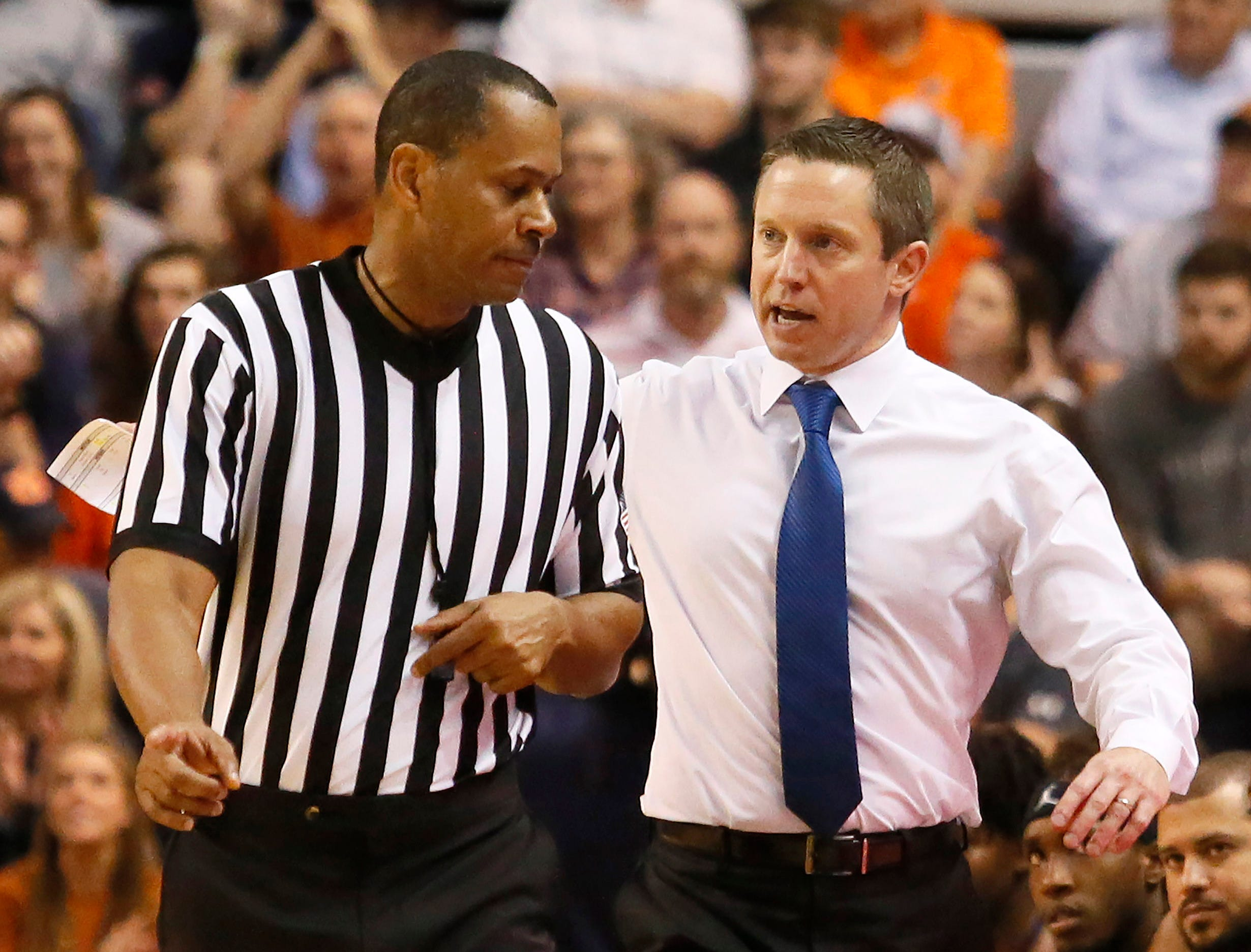 Feb 5, 2019; Auburn, AL, USA; Florida Gators head coach Mike White talks to an official during the first half against the Auburn Tigers at Auburn Arena. Mandatory Credit: John Reed-USA TODAY Sports