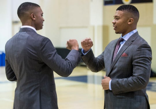 Collin Duncan, left, and his brother, CJ, fist bump before Collin announces his singing to Mississippi State during signing day at St. James High School in Montgomery, Ala., on Wednesday, Feb. 6, 2019.