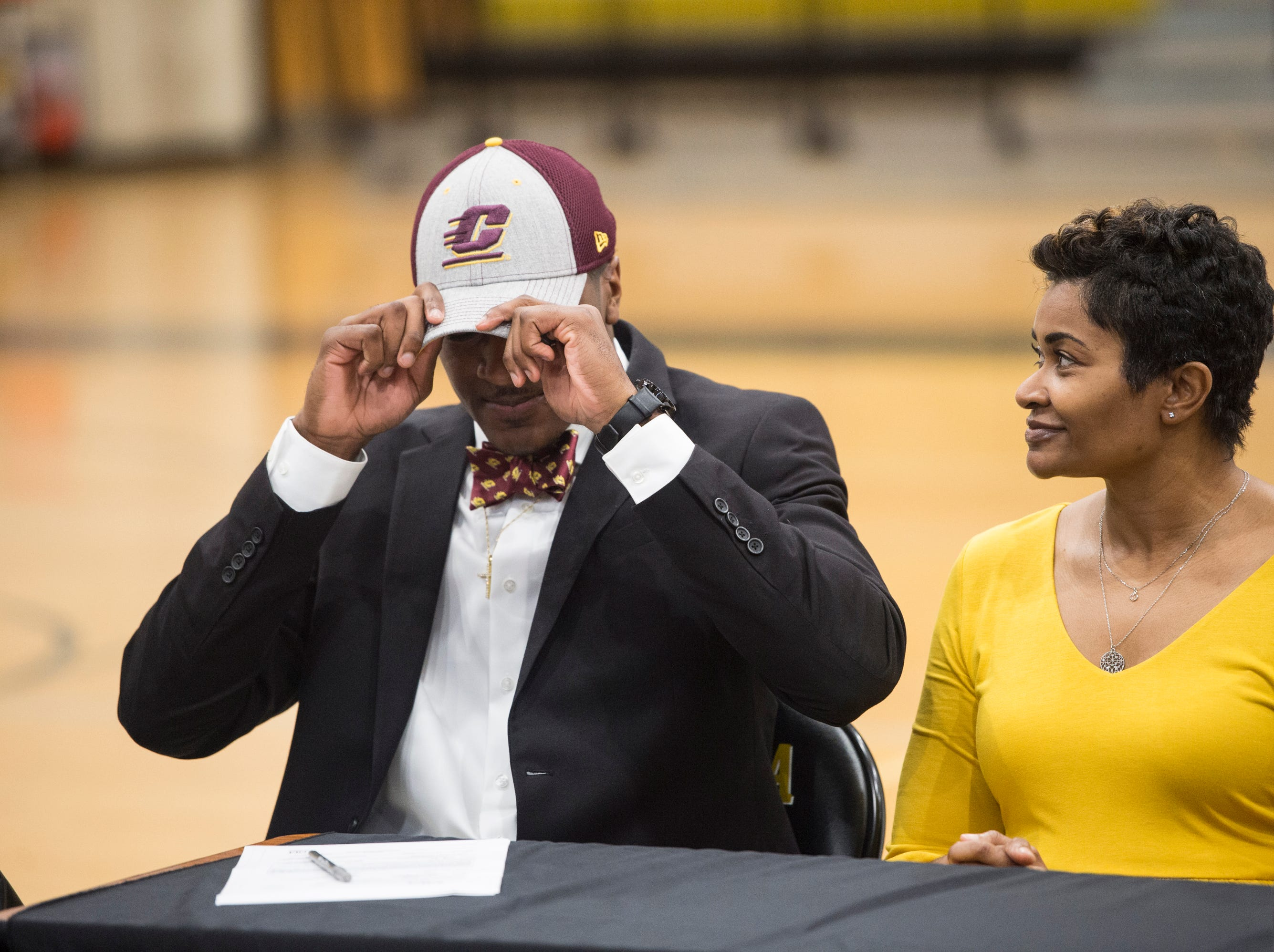 Trey Jones signs his letter of intent to Central Michigan during signing day at Wetumpka High School in Wetumpka, Ala., on Wednesday, Feb. 6, 2019.