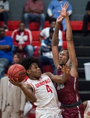 Lee guard Keon Lee (4) goes up for a layup at Lee High School in Montgomery, Ala., on Tuesday, Feb. 5, 2019. Lee defeated Prattville 79-23.