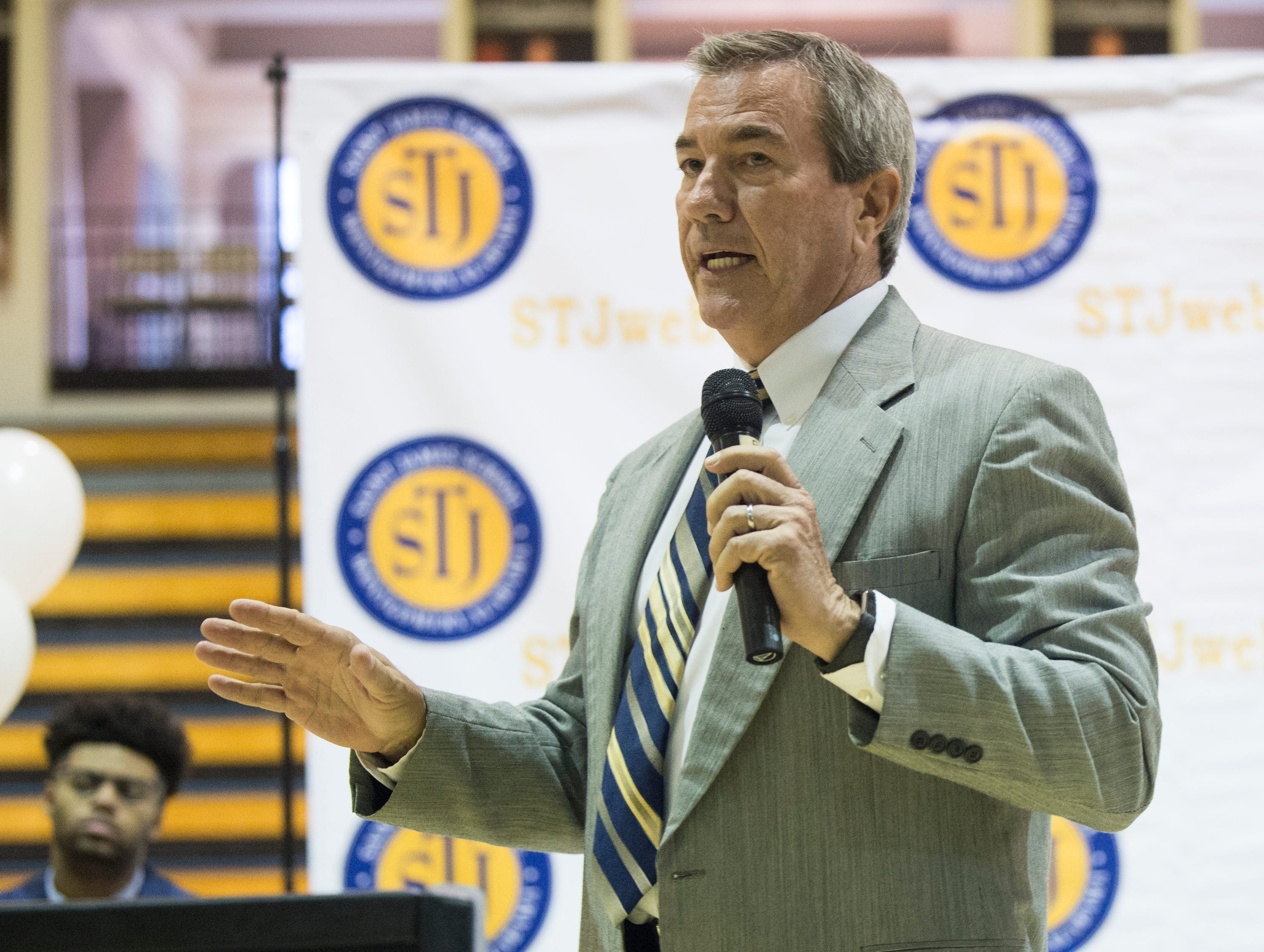 St. James coach Jimmy Perry speaks during signing day at St. James High School in Montgomery, Ala., on Wednesday, Feb. 6, 2019.