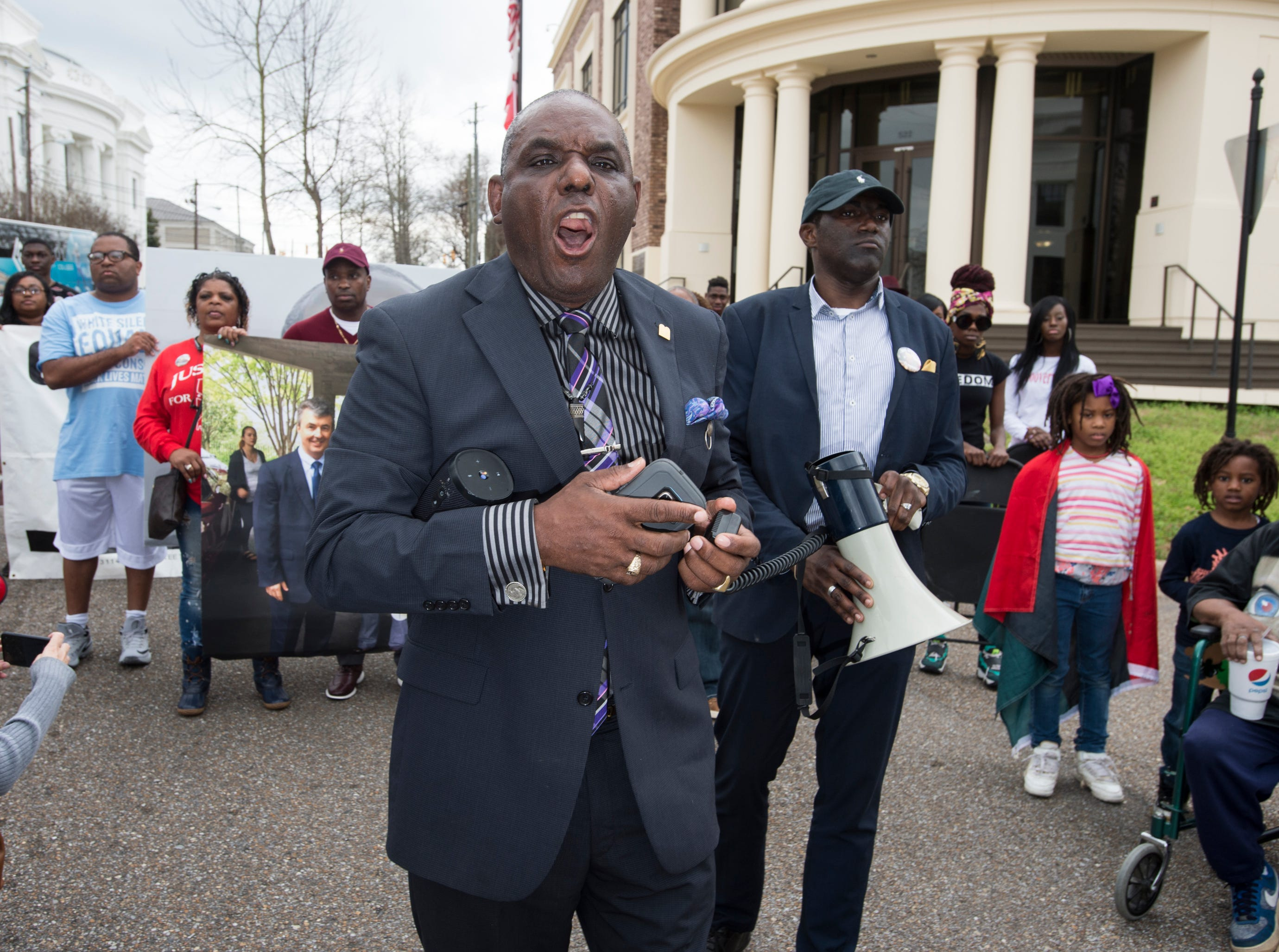 Protest organizer Frank Matthews joins EJ Bradford's family as they march around the Alabama Attorney General's office during a protest in Montgomery, Ala., on Wednesday, Feb. 6, 2019. EJ Bradford was shot and killed by police Nov. 22, 2018 in a Hoover, Ala. mall. Alabama Attorney General Steve Marshall announced Tuesday there would be no charges filed against the officer involved in the shooting.