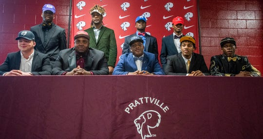 Prattville High School players, from left, Zach Boerner, Keshawn Pickett, Chris Bozeman, Kylan Pettway, Rodney Thompson, Tra Edwards, Malik Smith, Jake Howard and Jacquez Allen during college football signing day at the school's campus in Pratttville, Ala., on Wednesday February 6, 2019.