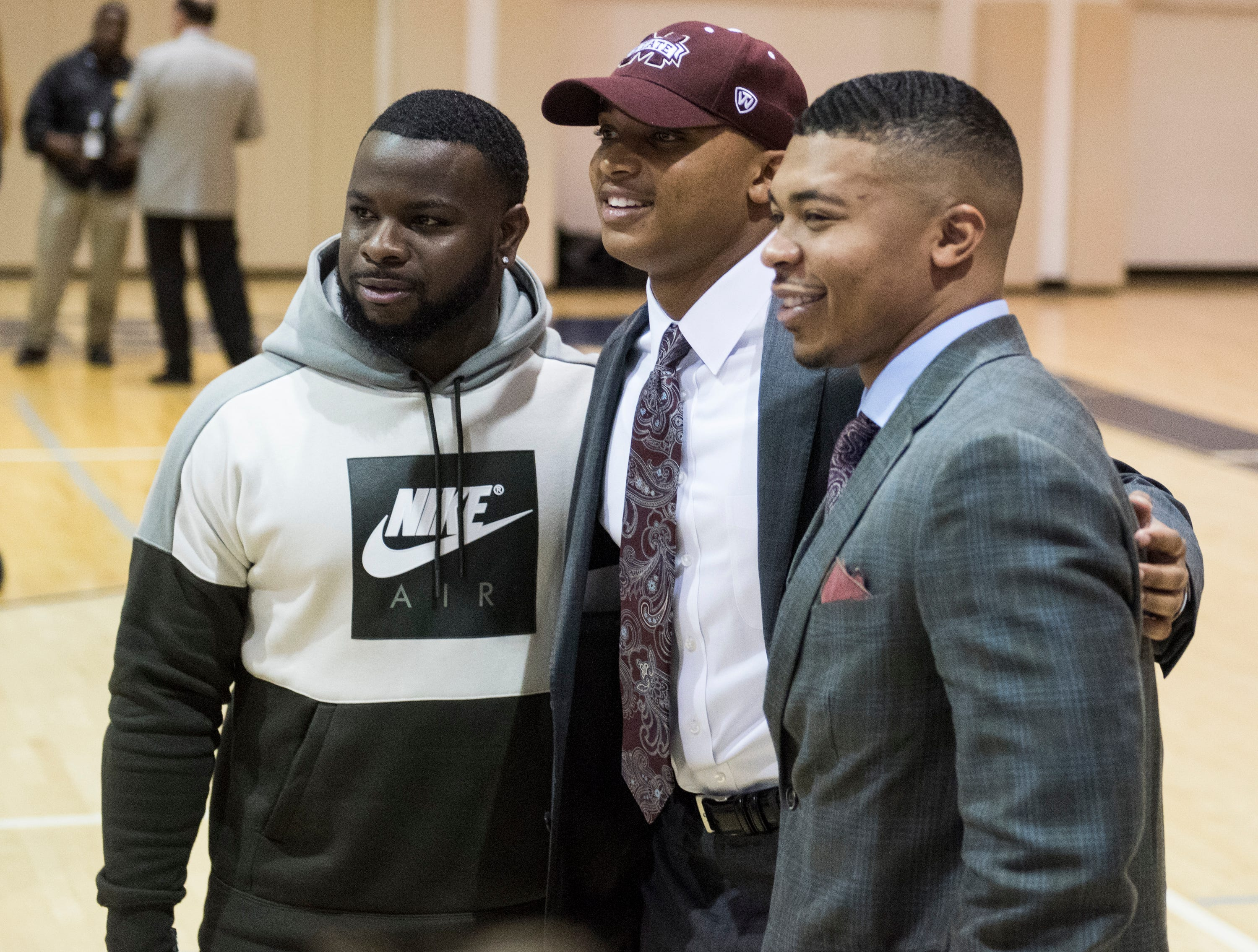 Collin Duncan poses with his trainer and his brother CJ Duncan during signing day at St. James High School in Montgomery, Ala., on Wednesday, Feb. 6, 2019.