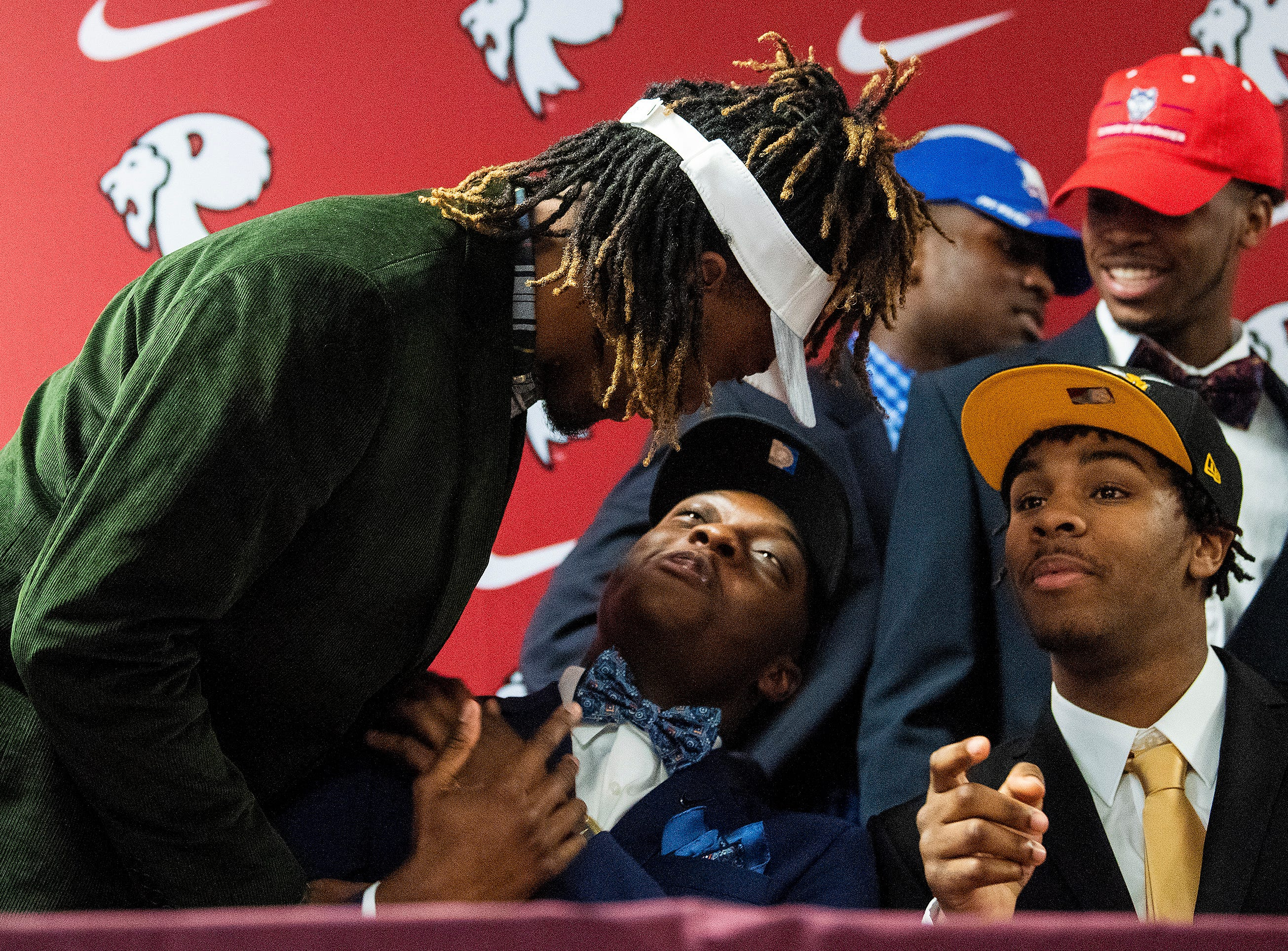 Prattville High School's Kylan Pettway, Rodney Thompson and Jake Howard during college football signing day at the school's campus in Pratttville, Ala., on Wednesday February 6, 2019.