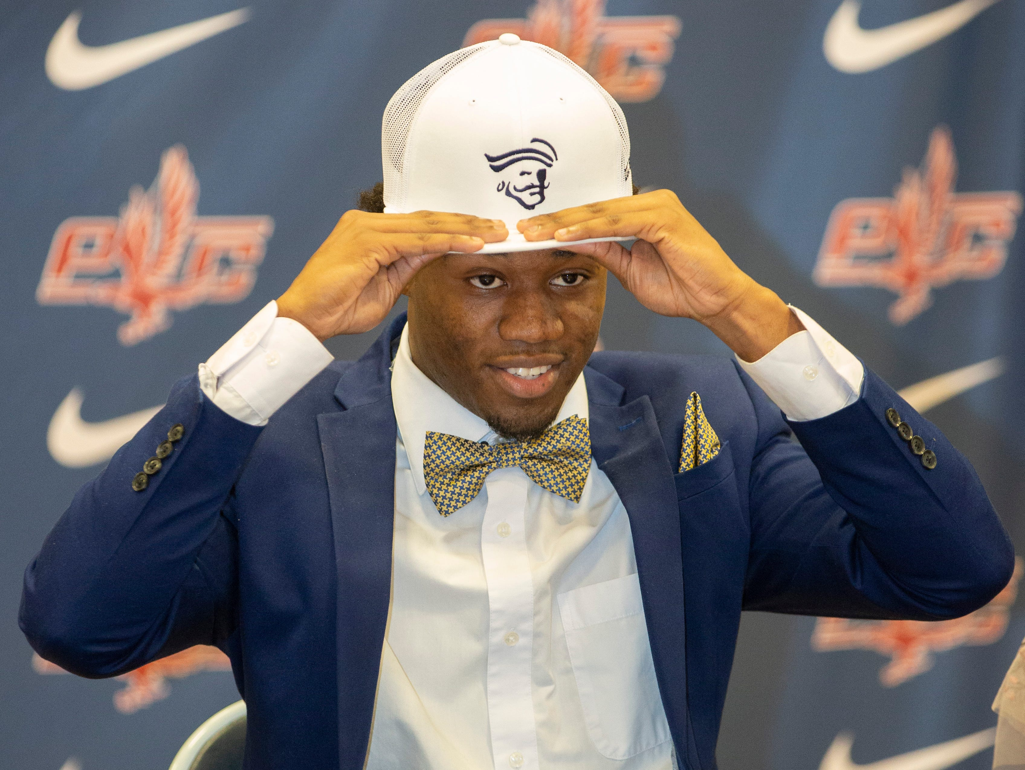 Laquez Cain, a football player at Park Crossing, signed with Independence Community College.