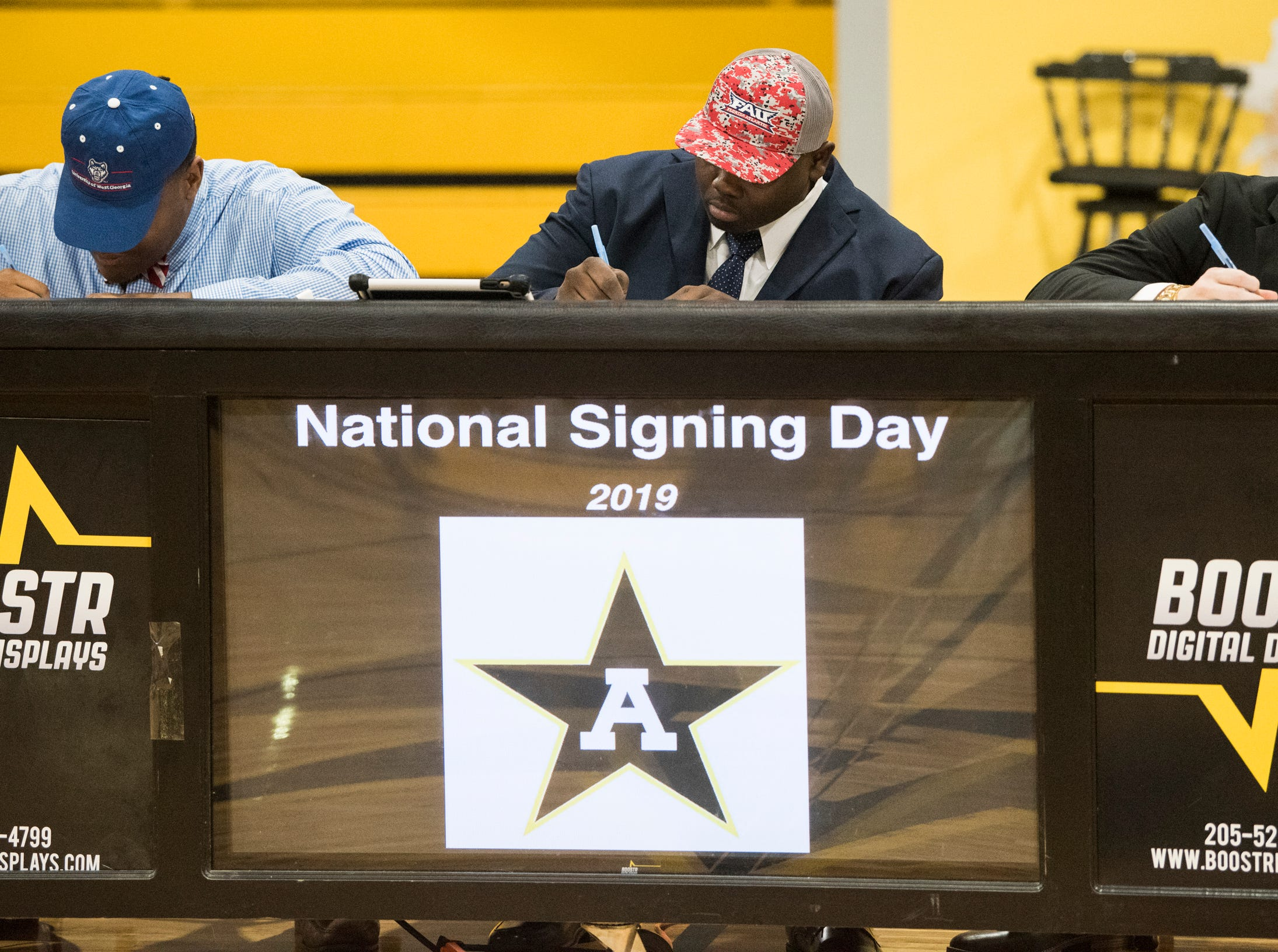 Players sign their letter of intent during signing day at Autauga Academy Prattville, Ala., on Wednesday, Feb. 6, 2019.