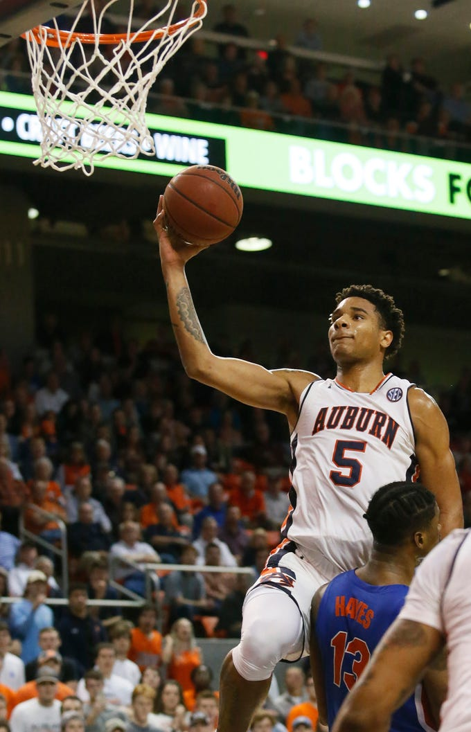 Feb 5, 2019; Auburn, AL, USA; Auburn Tigers forward Chuma Okeke (5) takes a shot over Florida Gators center Kevarrius Hayes (13) during the second half at Auburn Arena. Mandatory Credit: John Reed-USA TODAY Sports