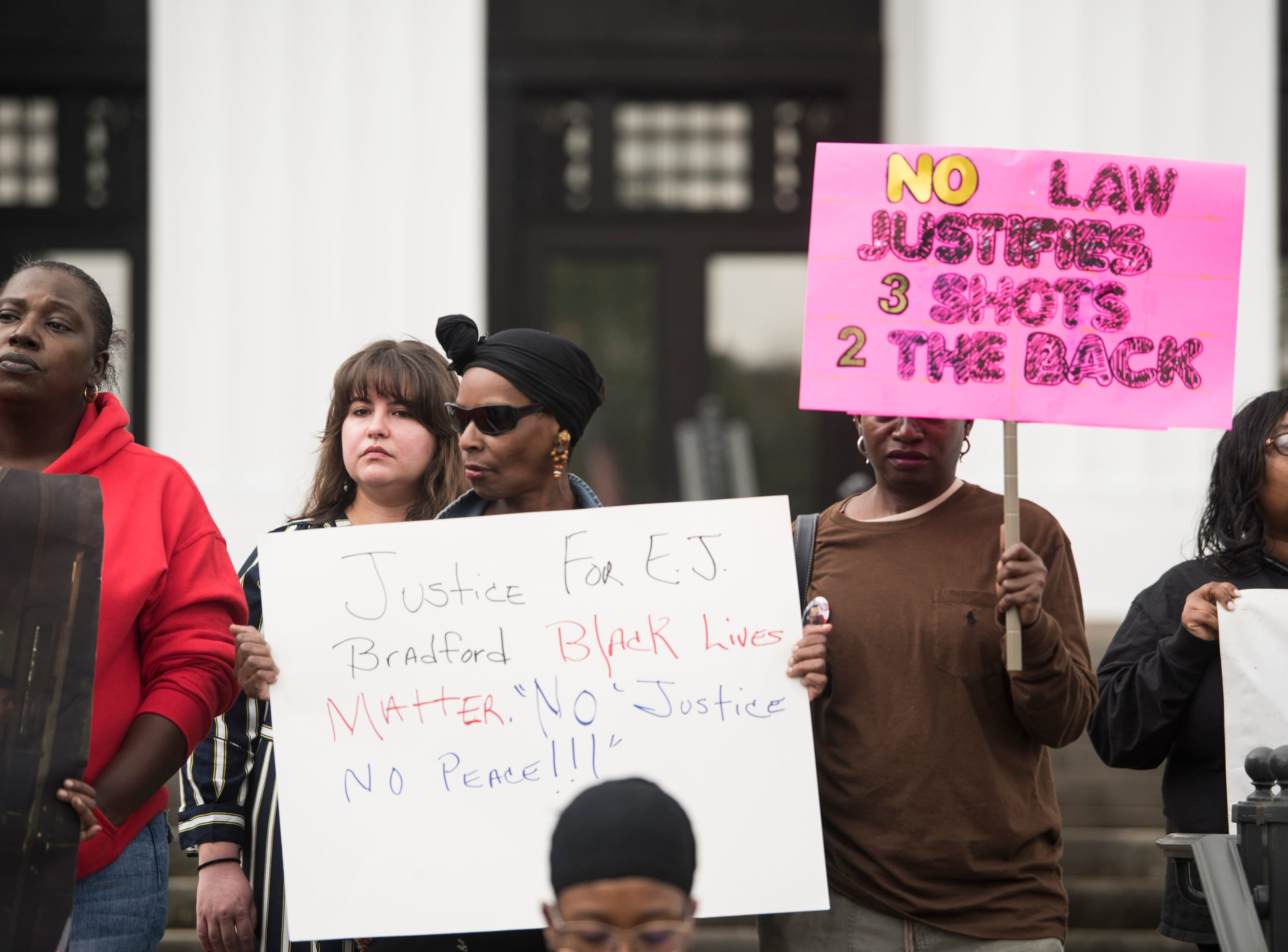 Protestors gather on the steps of the Attorney General's office during a protest in Montgomery, Ala., on Wednesday, Feb. 6, 2019. EJ Bradford was shot and killed by police Nov. 22, 2018 in a Hoover, Ala. mall. Alabama Attorney General Steve Marshall announced Tuesday there would be no charges filed against the officer involved in the shooting.